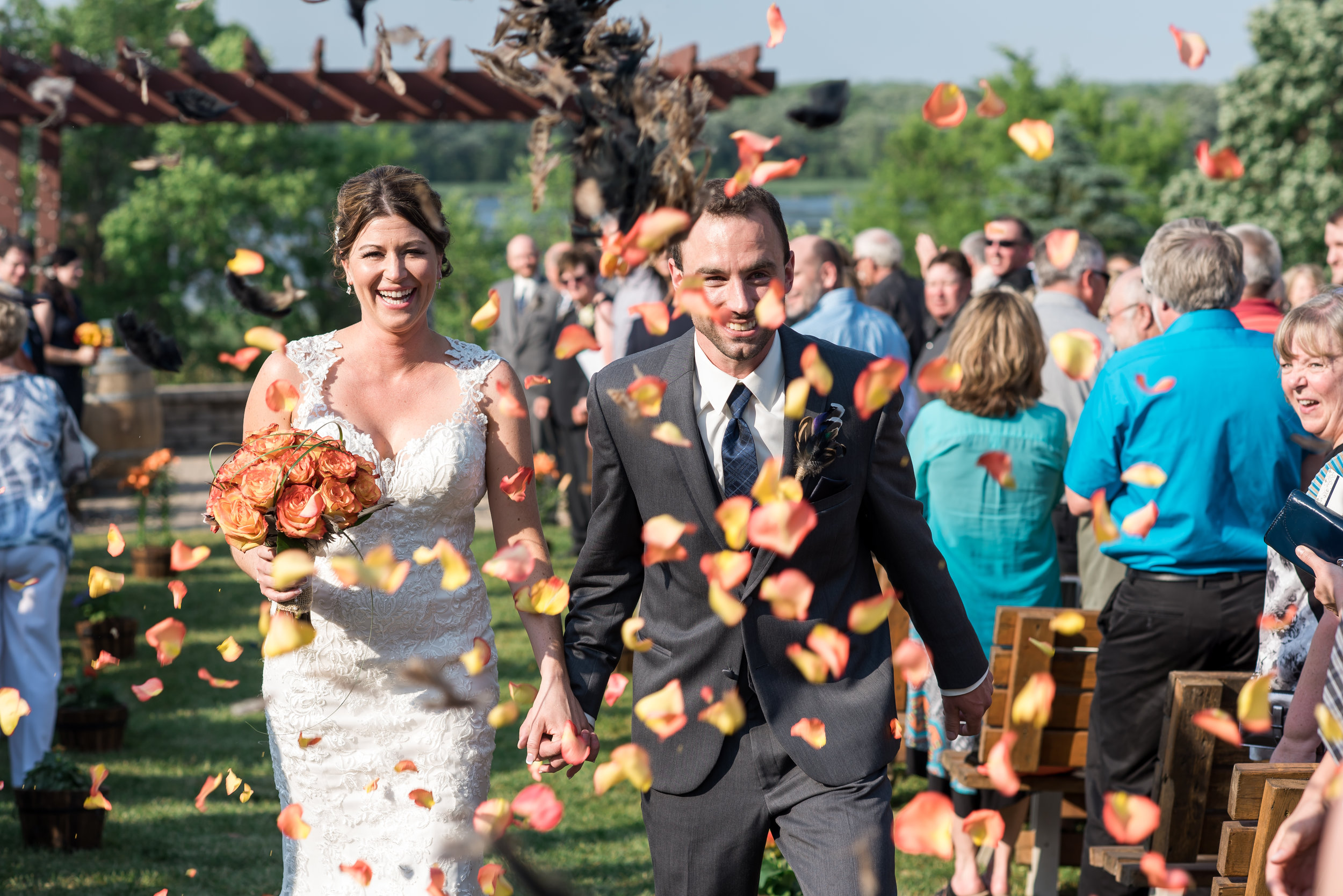 petals and duck feathers confetti recessional walk | Kelly Birch Photography :: Horse and Hunt Club :: Sixpence Events Minnesota wedding planner .jpg