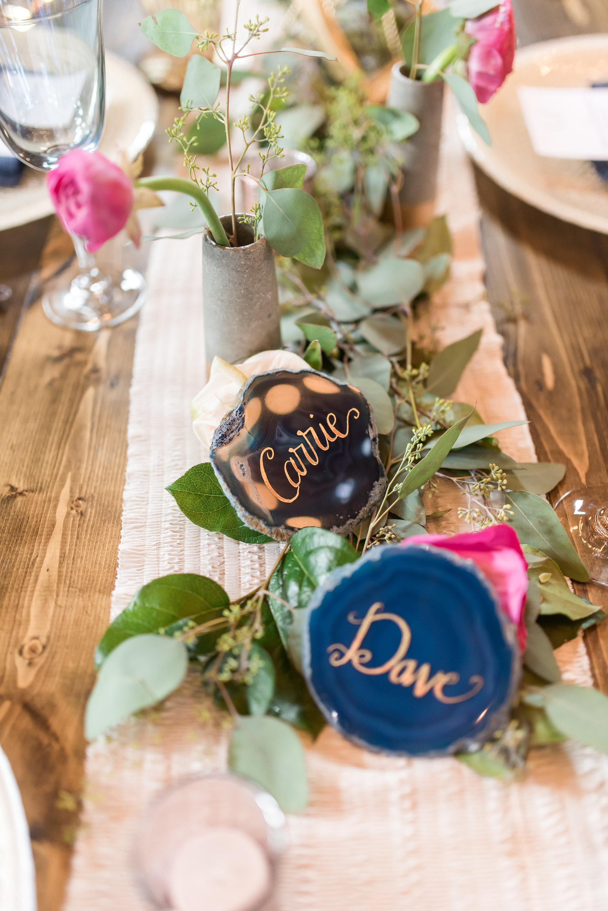table runner with concrete vases with ranunculus and seeded eucalyptus | Kelly Birch Photography :: Bloom Lake Barn :: Sixpence Events Minnesota wedding planner :: A Vintage Touch Weddings :: Brett Dorian.jpg