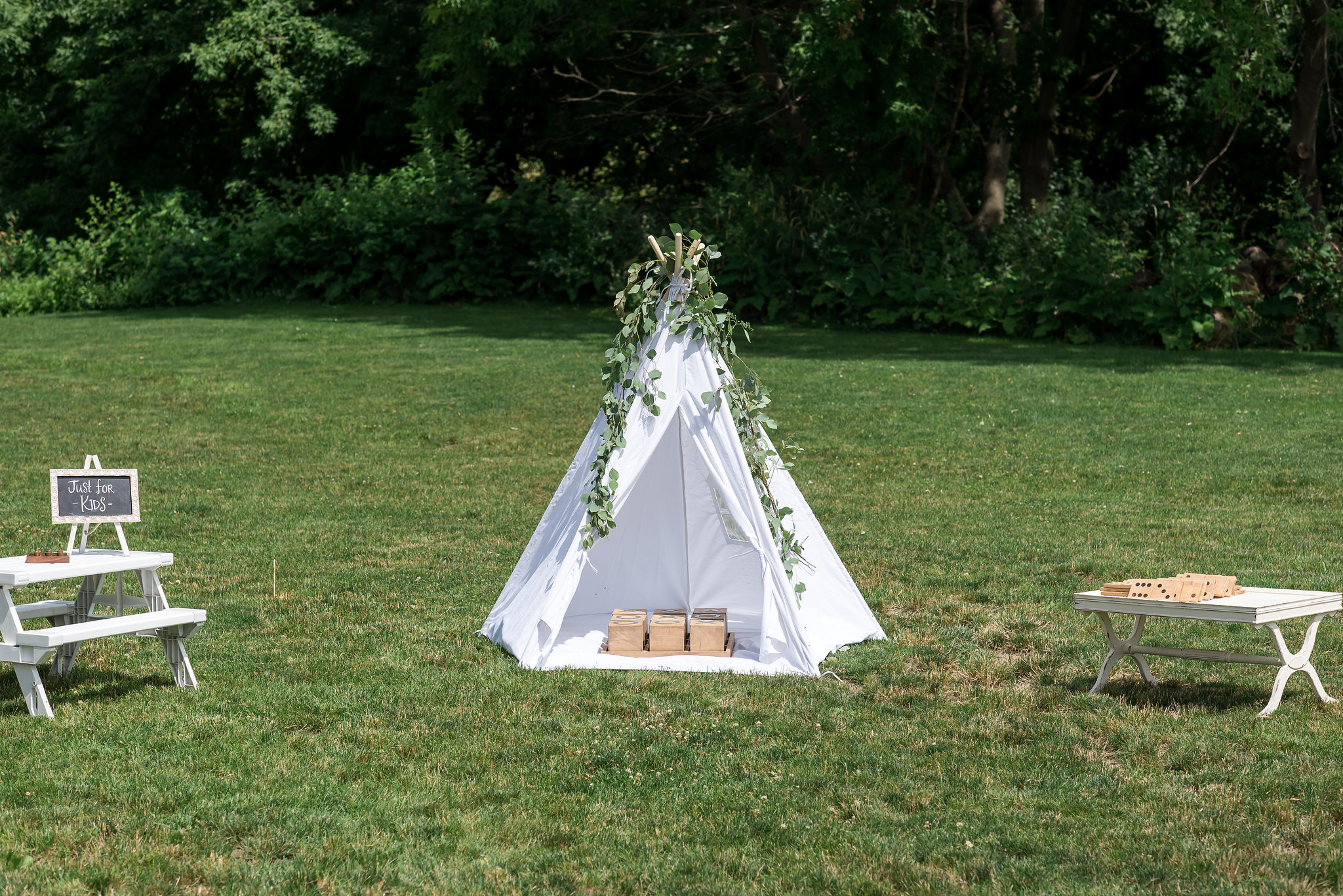 kids station with tee pee | Kelly Birch Photography :: Bloom Lake Barn :: Sixpence Events Minnesota wedding planner :: A Vintage Touch Weddings :: Brett Dorian.jpg