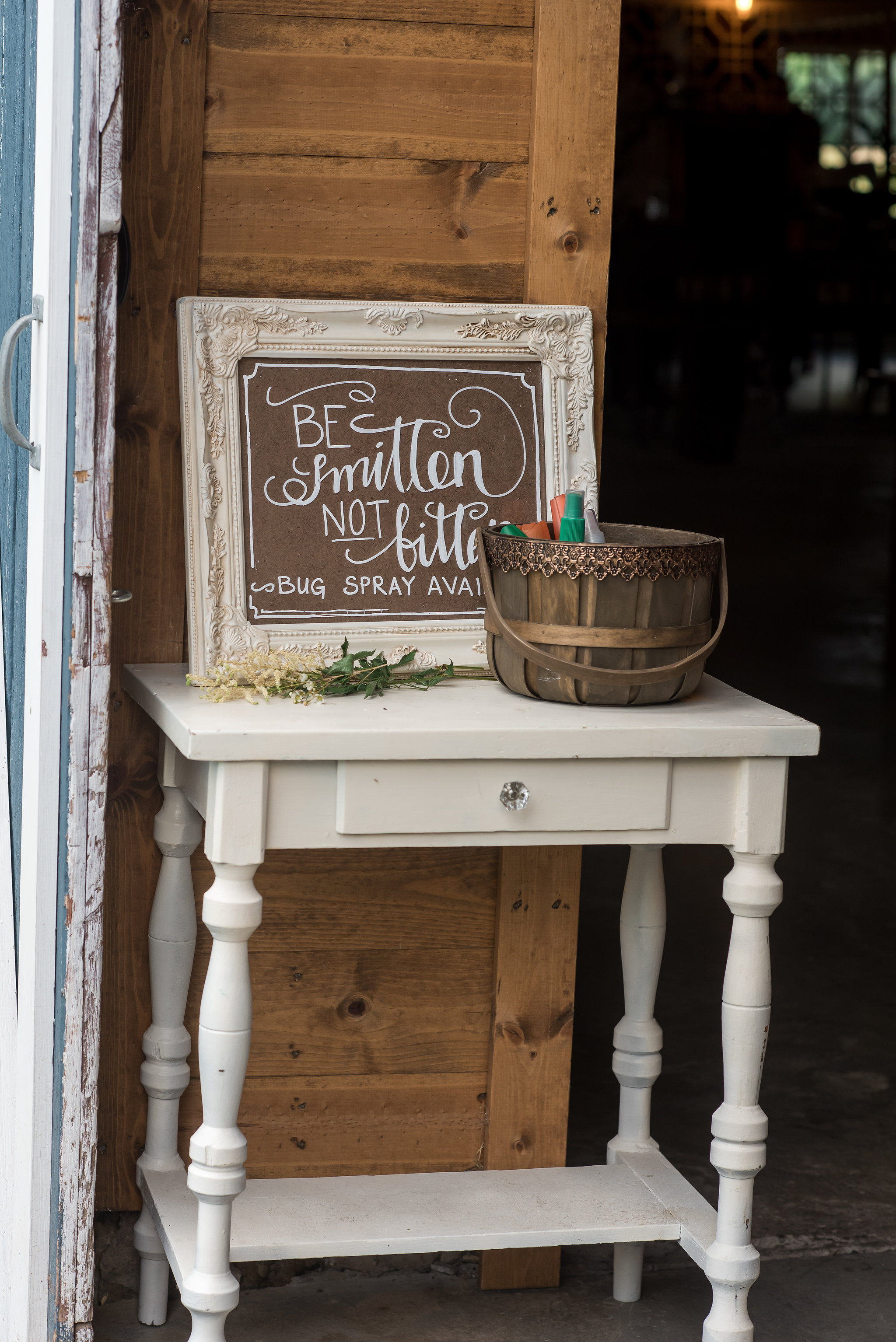 be smitten not bitten bug bite repellant station | Kelly Birch Photography :: Bloom Lake Barn :: Sixpence Events Minnesota wedding planner :: A Vintage Touch Weddings :: Brett Dorian.jpg