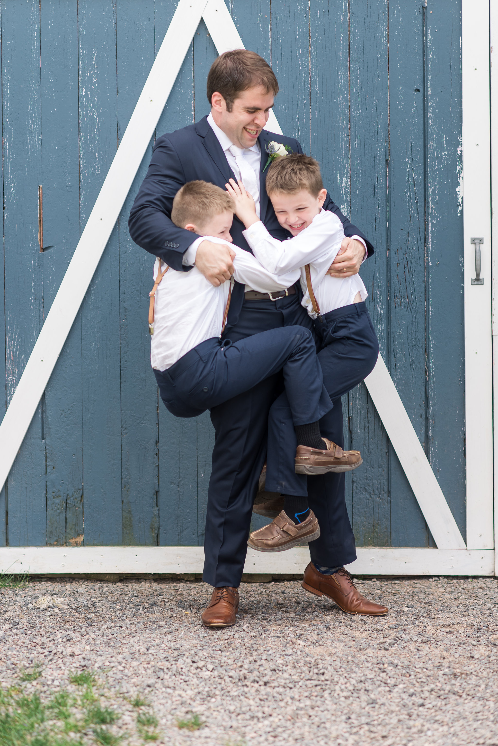 ring bearers hug groom | Kelly Birch Photography :: Bloom Lake Barn :: Sixpence Events Minnesota wedding planner :: A Vintage Touch Weddings :: Brett Dorian.jpg
