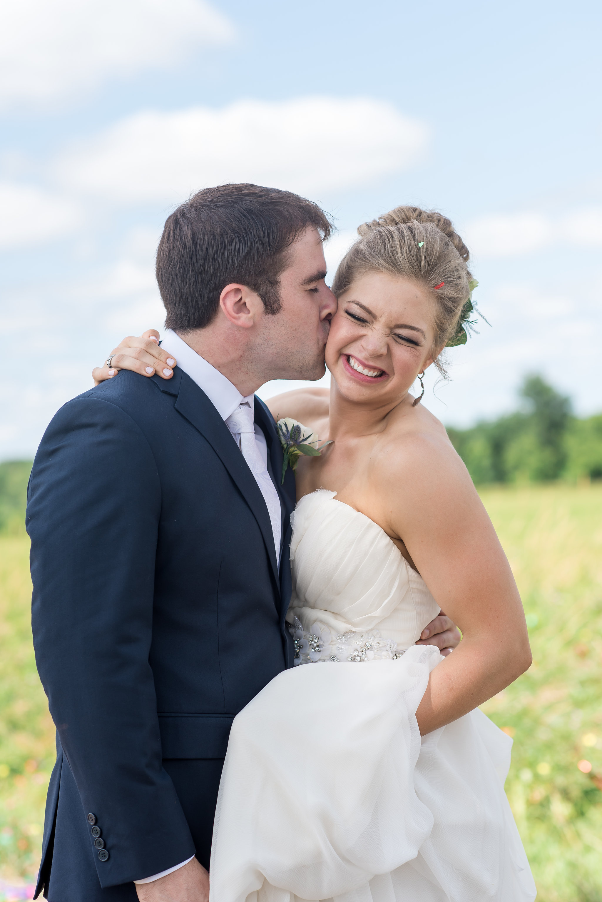 cheek kiss | Kelly Birch Photography :: Bloom Lake Barn :: Sixpence Events Minnesota wedding planner :: A Vintage Touch Weddings :: Brett Dorian.jpg