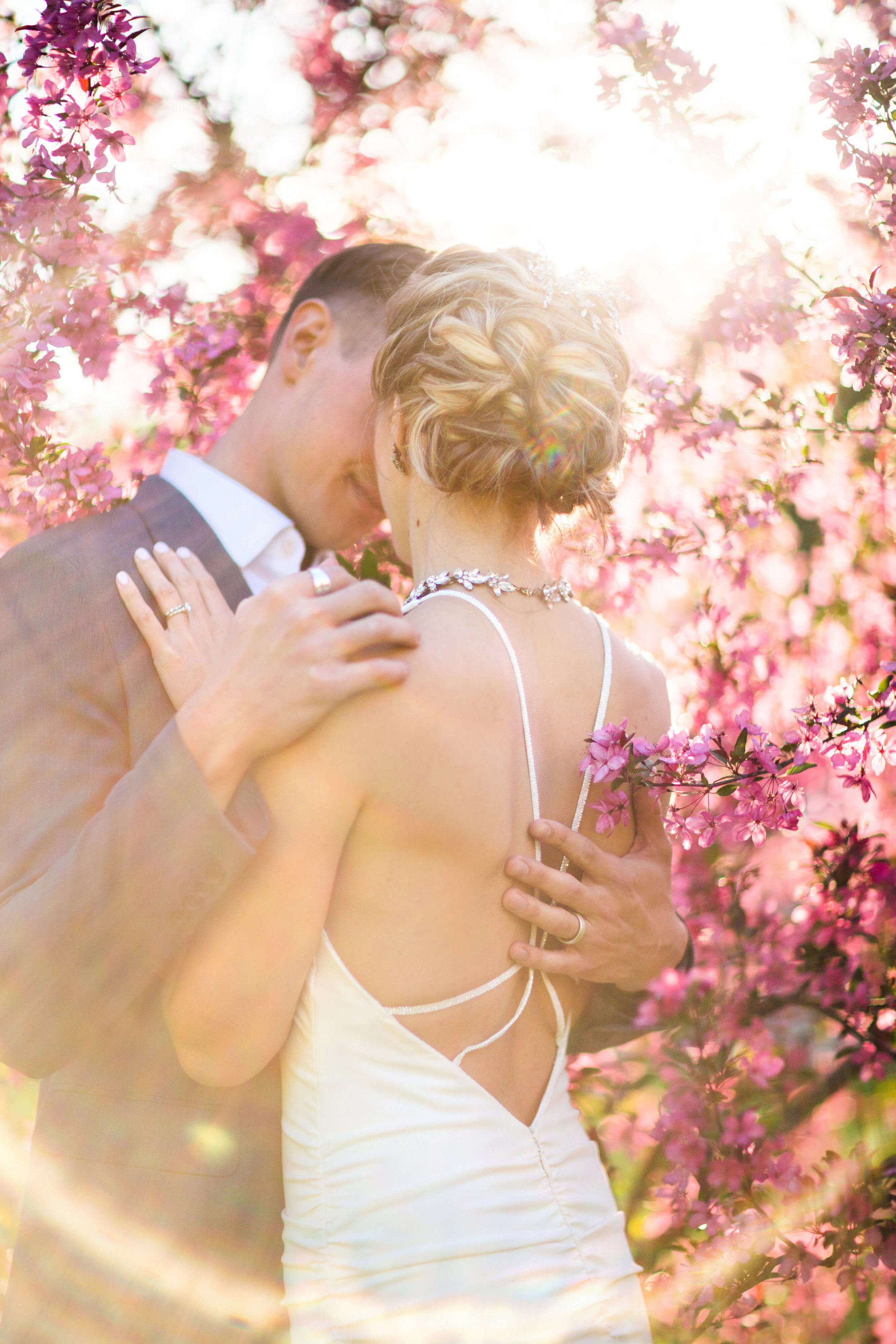 cherry blossoms | strappy bridal gown back | Sixpence Events & Planning free blog | Studio KH wedding photographer | groom with pointer finger ring