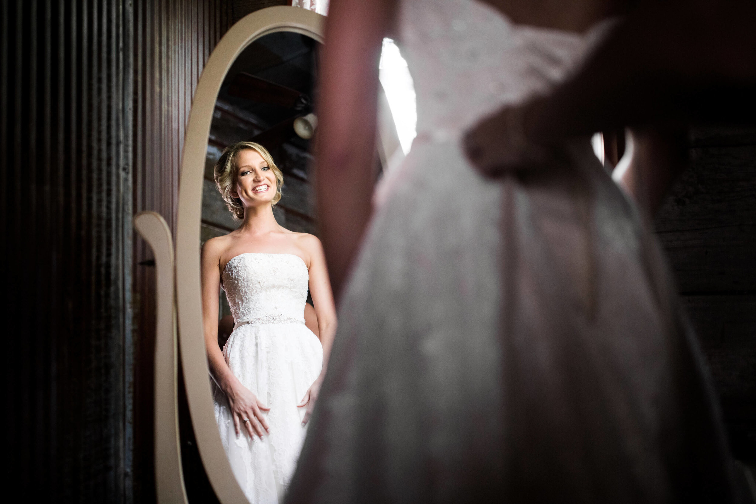 Studio KH wedding photographer | Sixpence Events and Planning, free wedding blog, free wedding help, free wedding advice | bride looking at herself in the mirror