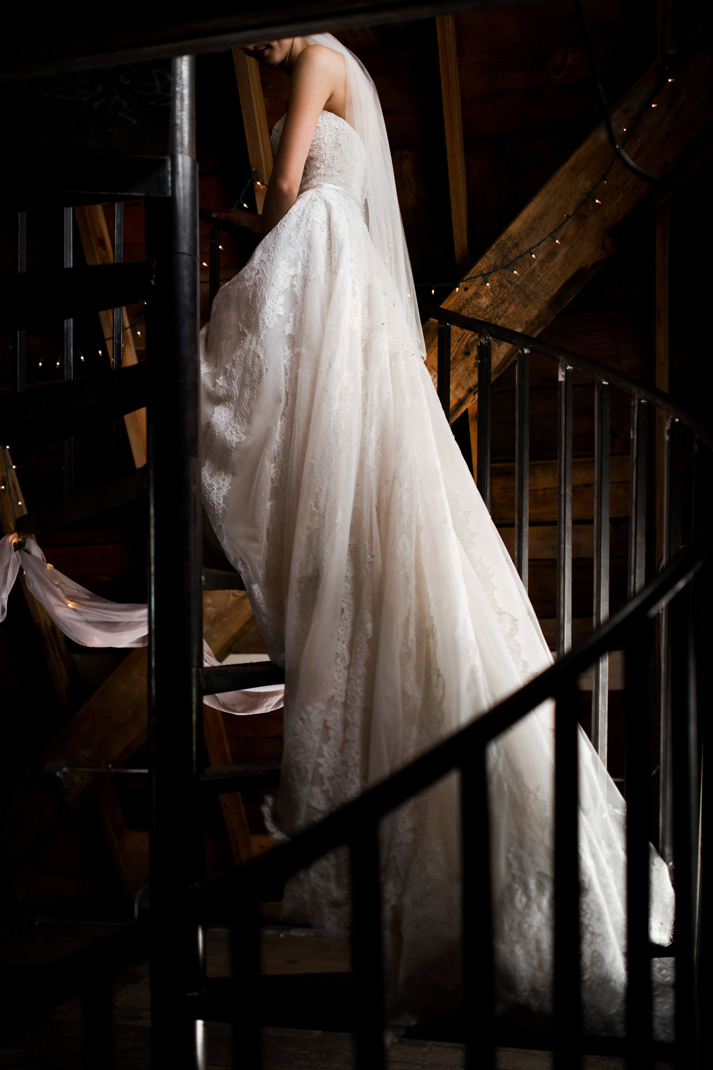 Studio KH wedding photographer | Sixpence Events and Planning, free wedding blog, free wedding help, free wedding advice | bride walking up spiral staircase