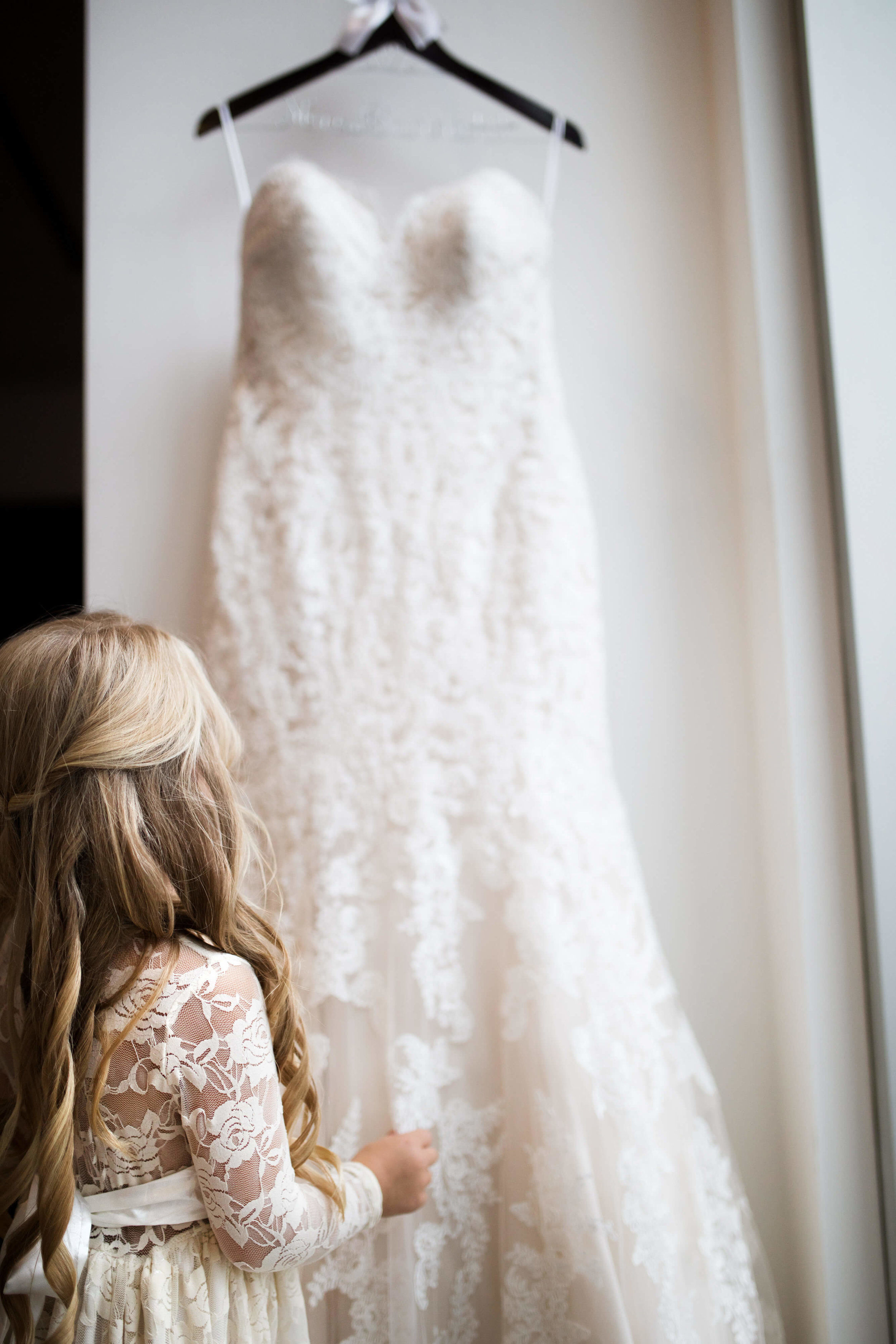 Studio KH wedding photographer | Sixpence Events and Planning, free wedding blog, free wedding help, free wedding advice | flower girl looking at the dress