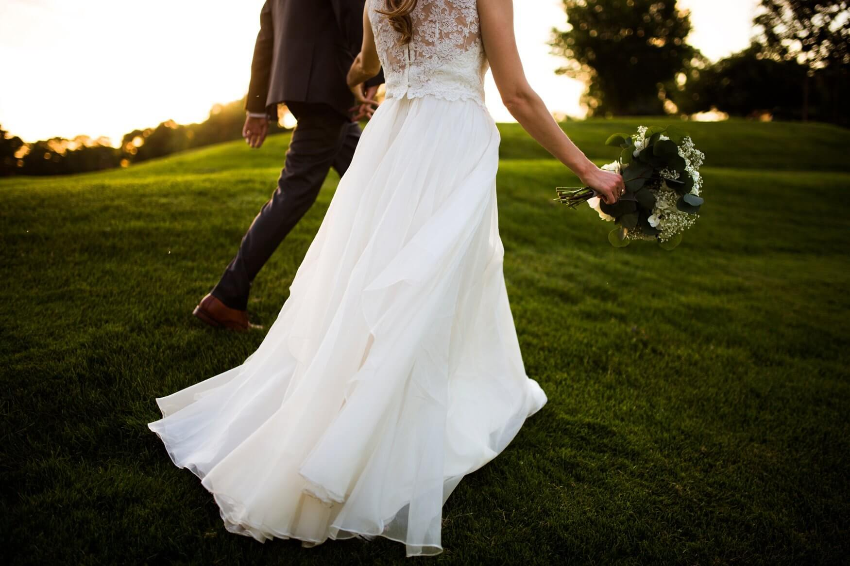 golden hour photos | bride with lace top separates | Minnesota wedding photographer Studio KH wedding dress details | wedding blog | Sixpence Events 70 Ways to Photograph Your Wedding Dress.jpg