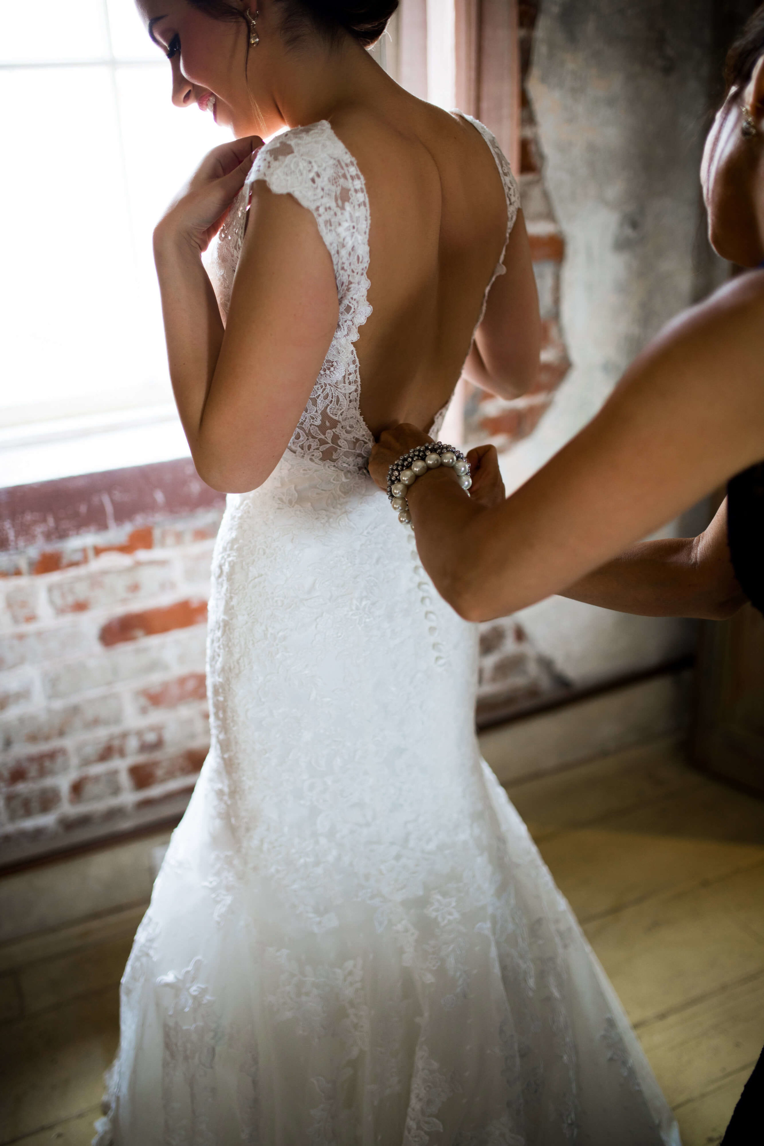 bride getting into her dress, cap sleeves Studio KH wedding photographer | Sixpence Events and Planning, free wedding blog, free wedding help, free wedding advice |