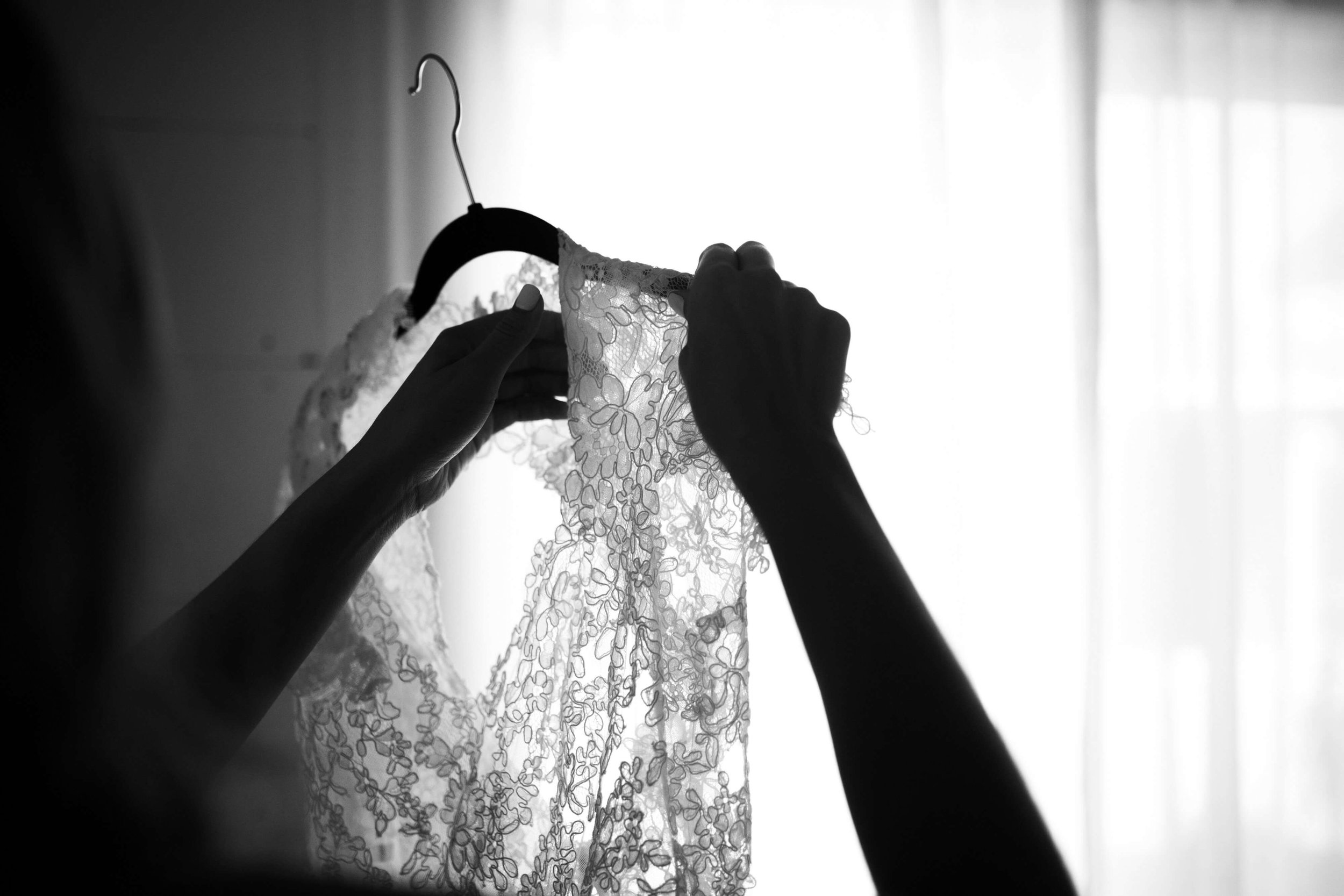taking my dress off of the hanger photo | Studio KH | Sixpence Events Minneapolis wedding planner