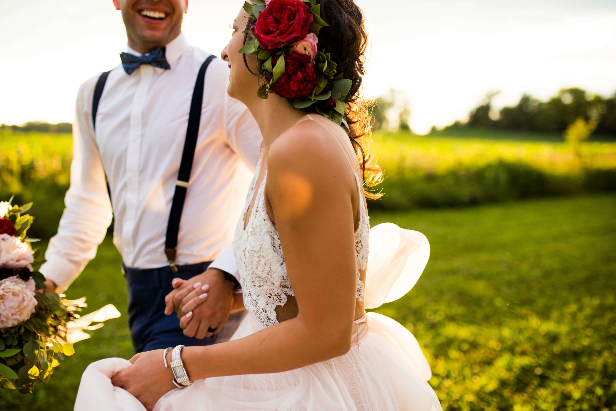 farm wedding | groom in bowtie and suspenders no boutonniere | bride with a watch on and large hair piece | Minnesota wedding photographer Studio KH wedding dress details | wedding blog | Sixpence Events 70 Ways to Photograph Your Wedding Dress.jpg