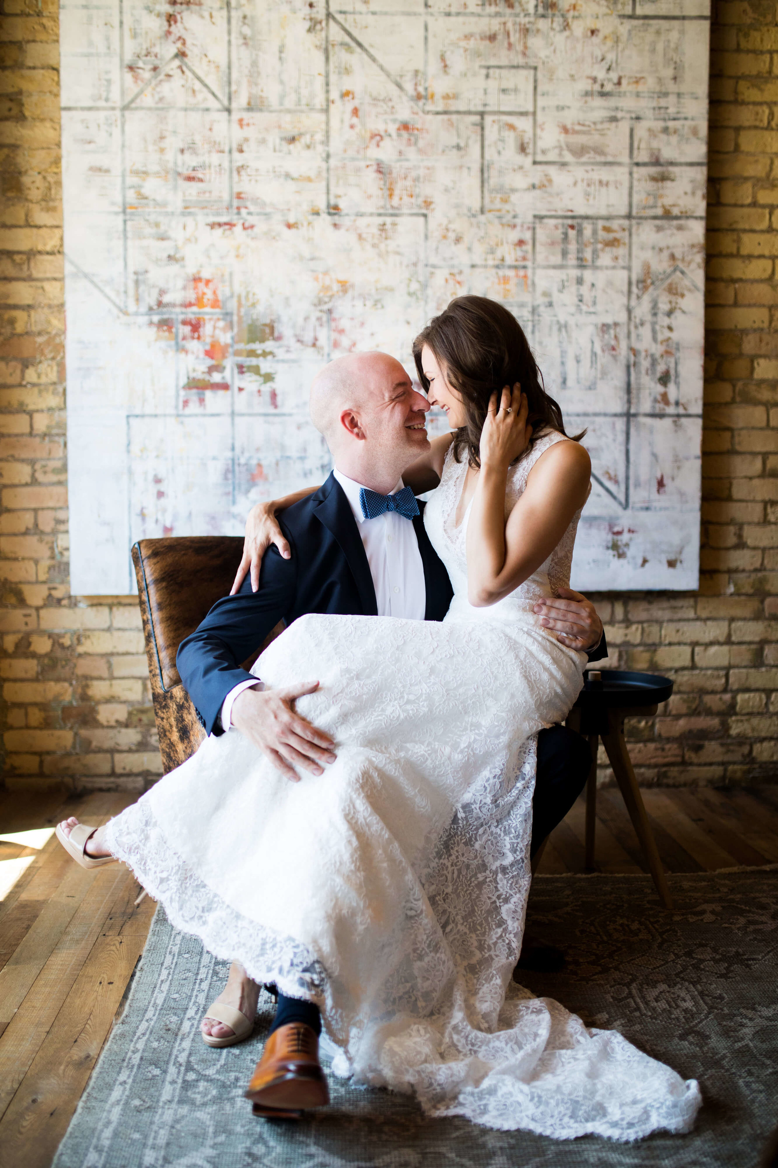 Studio KH wedding photographer | Sixpence Events and Planning, free wedding blog, free wedding help, free wedding advice | bride sitting on grooms lap | groom with blue bowtie