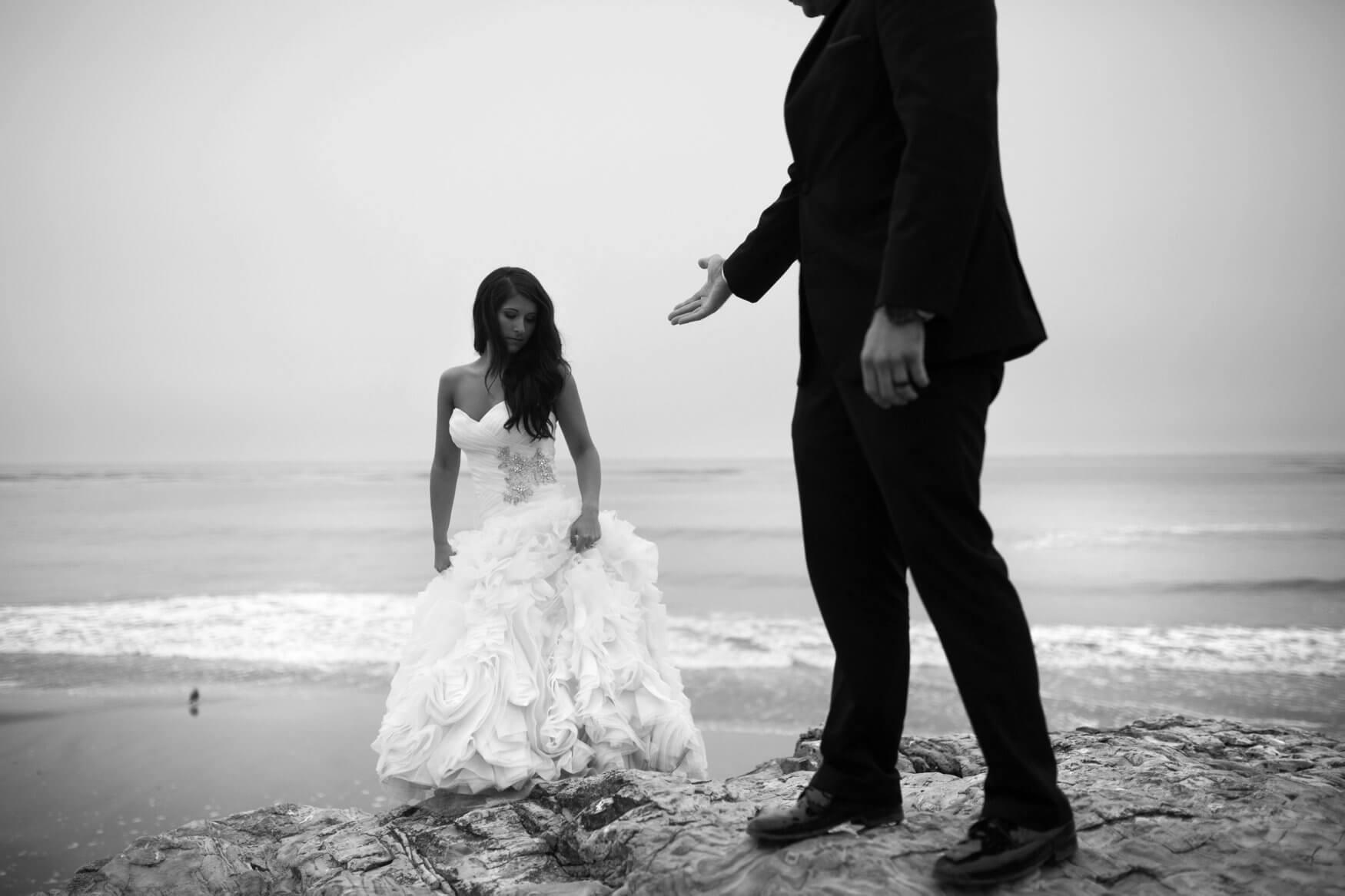 groom helping bride up rocks on Lake Superior | Minnesota wedding photographer Studio KH wedding dress details | wedding blog | Sixpence Events 70 Ways to Photograph Your Wedding Dress.jpg
