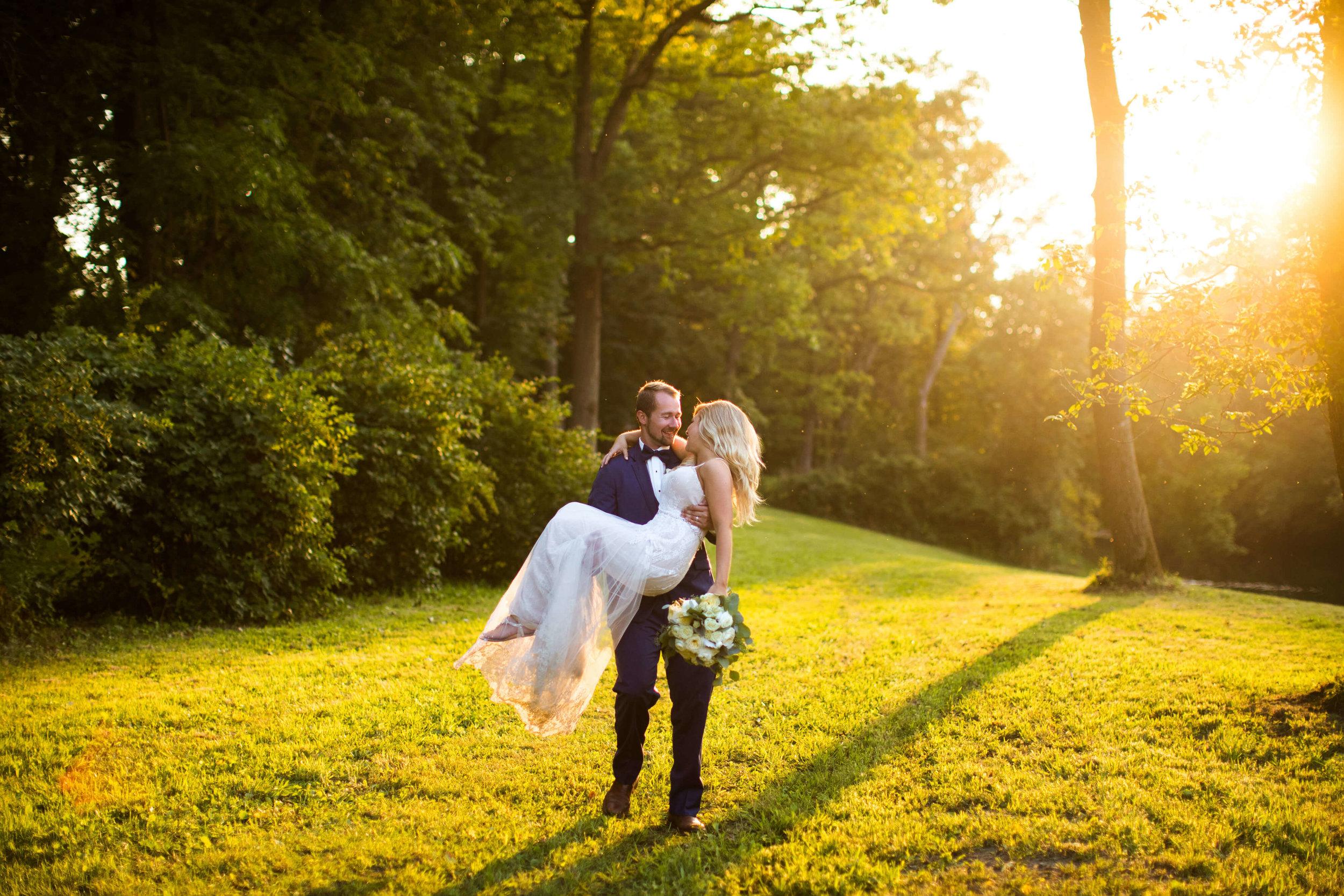 groom carrying bride golden hour | Minnesota wedding photographer Studio KH wedding dress details | wedding blog | Sixpence Events 70 Ways to Photograph Your Wedding Dress.jpg