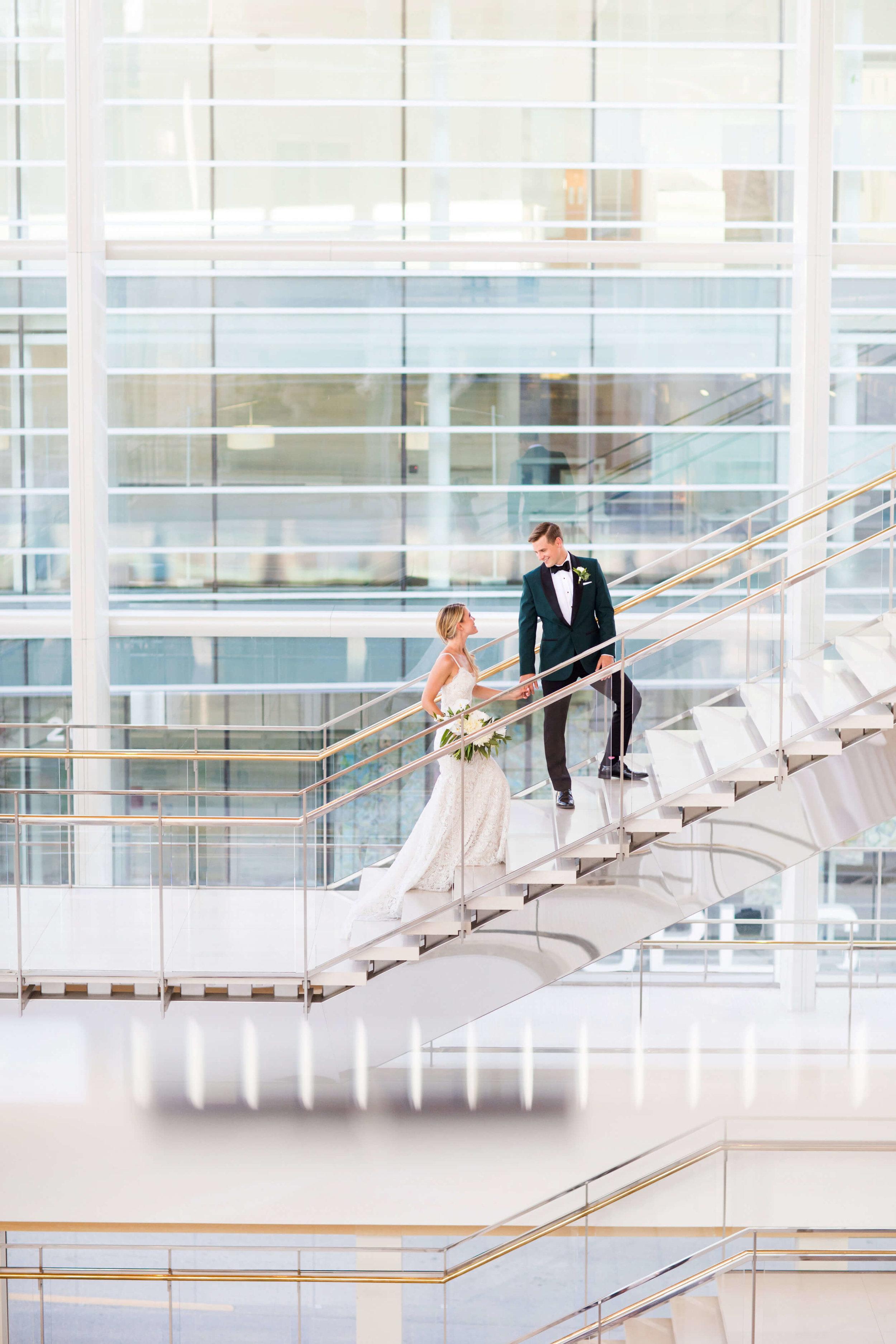 bride and groom walking up the stairs | Minnesota wedding photographer Studio KH wedding dress details | wedding blog | Sixpence Events 70 Ways to Photograph Your Wedding Dress.jpg