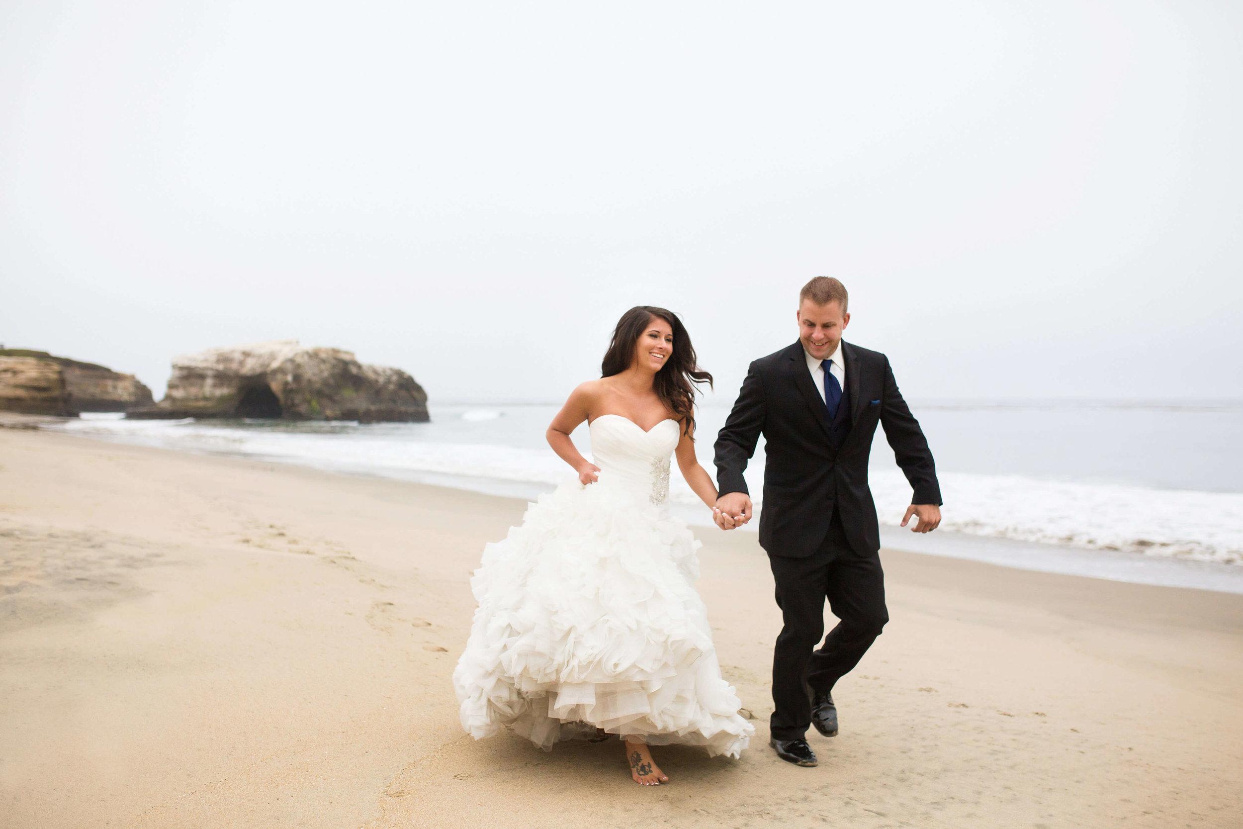 bride and groom running on the beach | Minnesota wedding photographer Studio KH wedding dress details | wedding blog | Sixpence Events 70 Ways to Photograph Your Wedding Dress.jpg