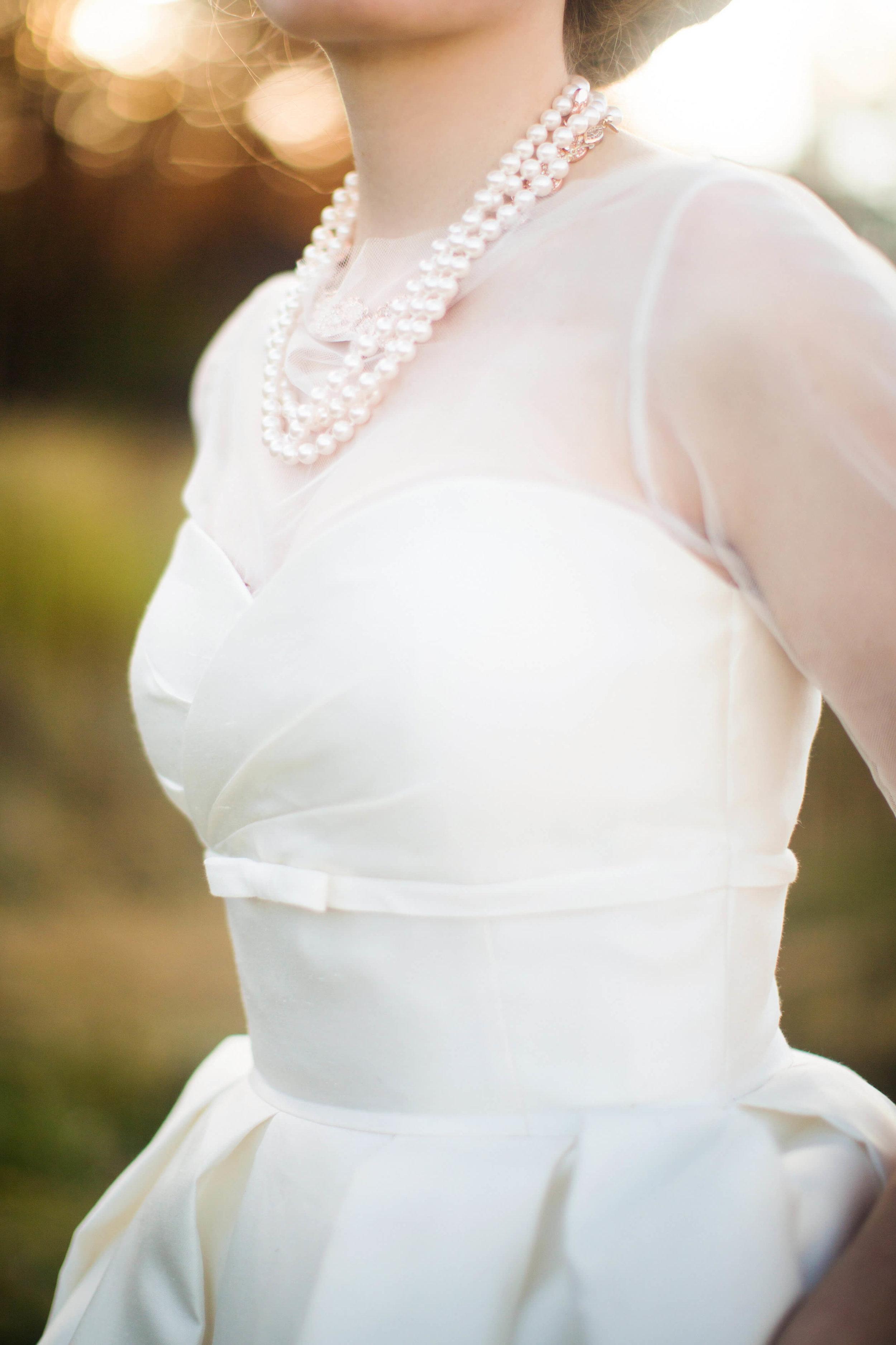 bride in pearls | Minnesota wedding photographer Studio KH wedding dress details | wedding blog | Sixpence Events 70 Ways to Photograph Your Wedding Dress.jpg