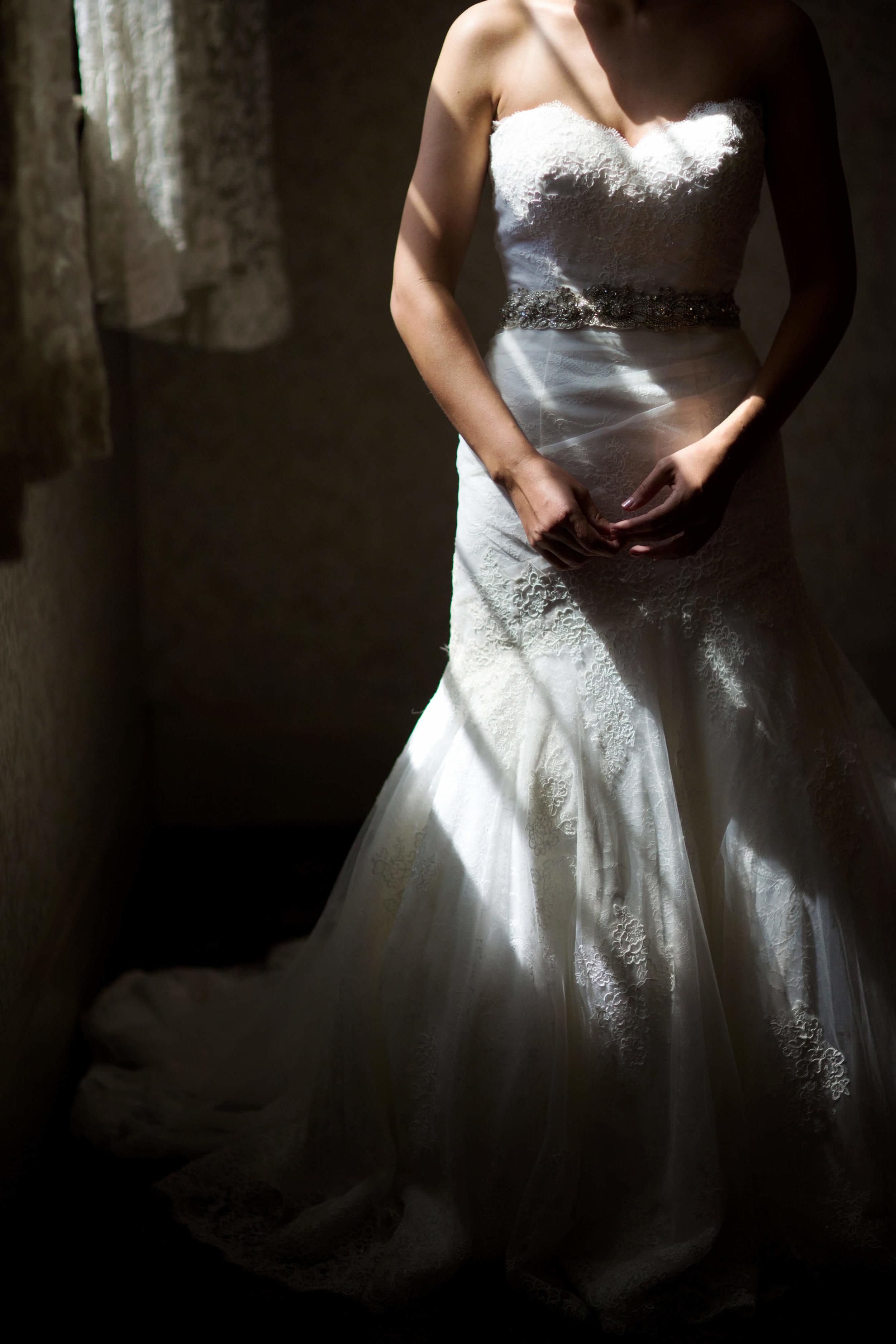 bride standing in the window light | Minnesota wedding photographer Studio KH wedding dress details | wedding blog | Sixpence Events 70 Ways to Photograph Your Wedding Dress.jpg