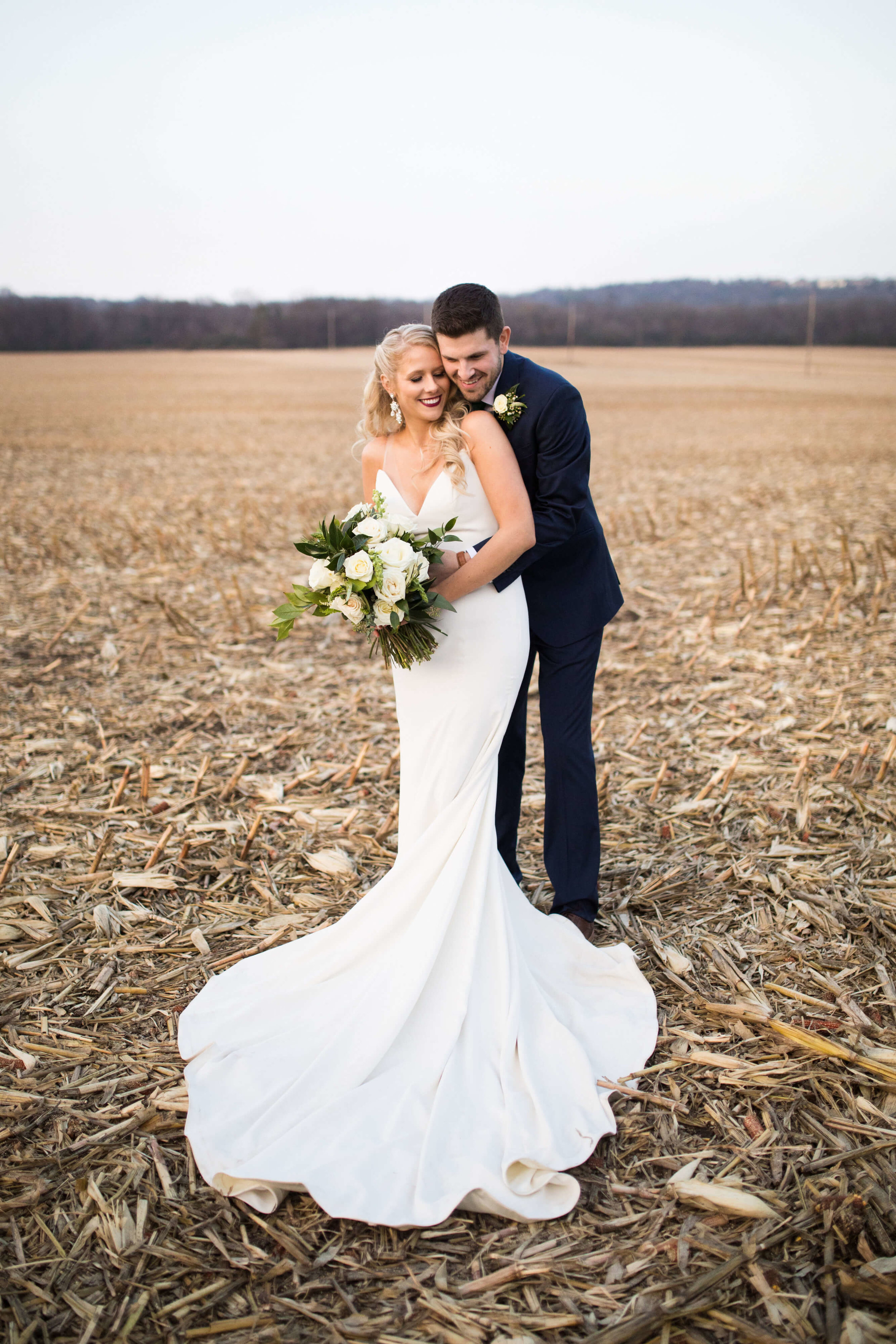 harvested field | long train | green and white bouquet | v neck dress | Minnesota wedding photographer Studio KH wedding dress details | wedding blog | Sixpence Events 70 Ways to Photograph Your Wedding Dress.jpg