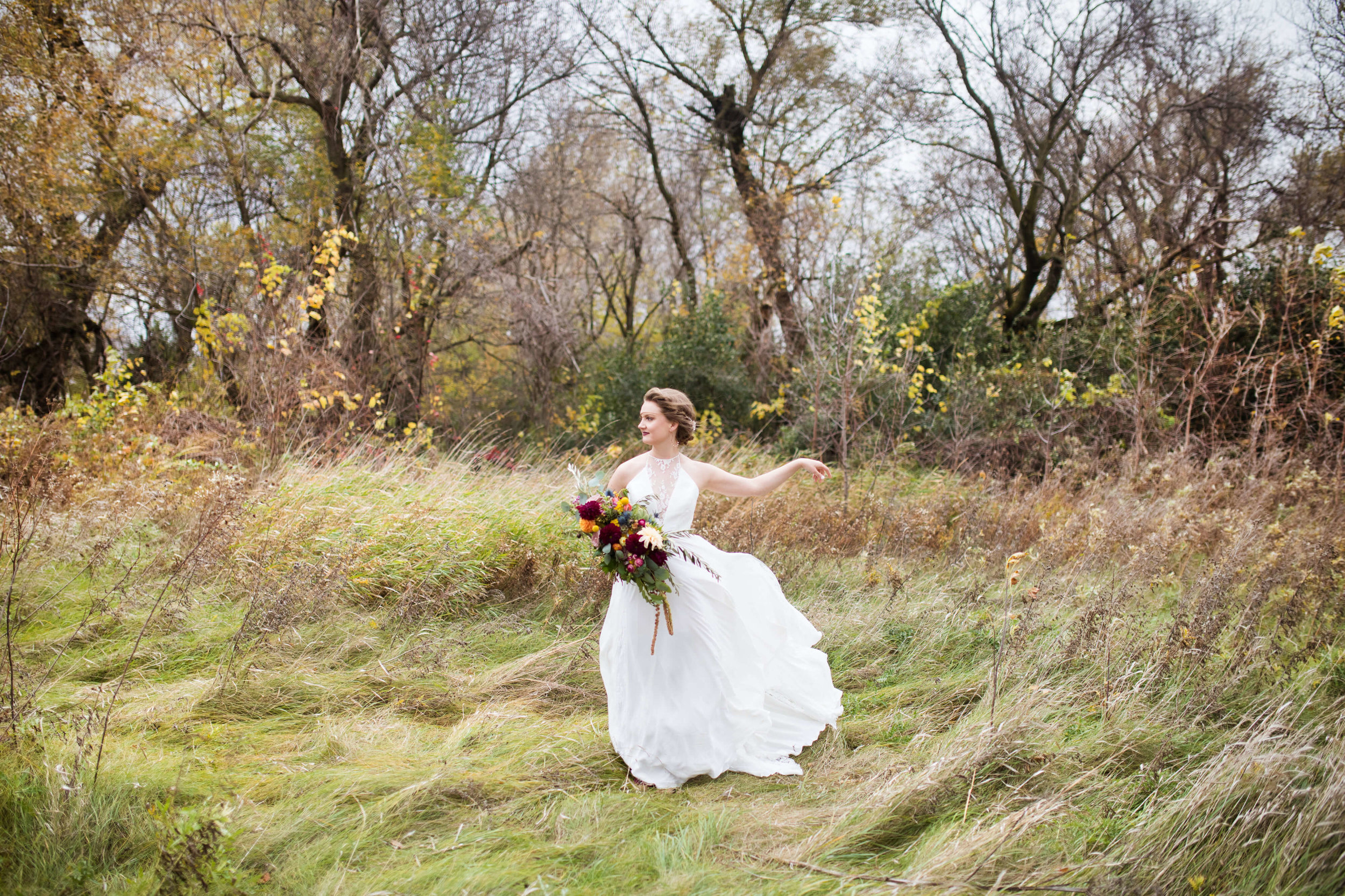 bride in the field with harvest bouquet | Minnesota wedding photographer Studio KH wedding dress details | wedding blog | Sixpence Events 70 Ways to Photograph Your Wedding Dress.jpg