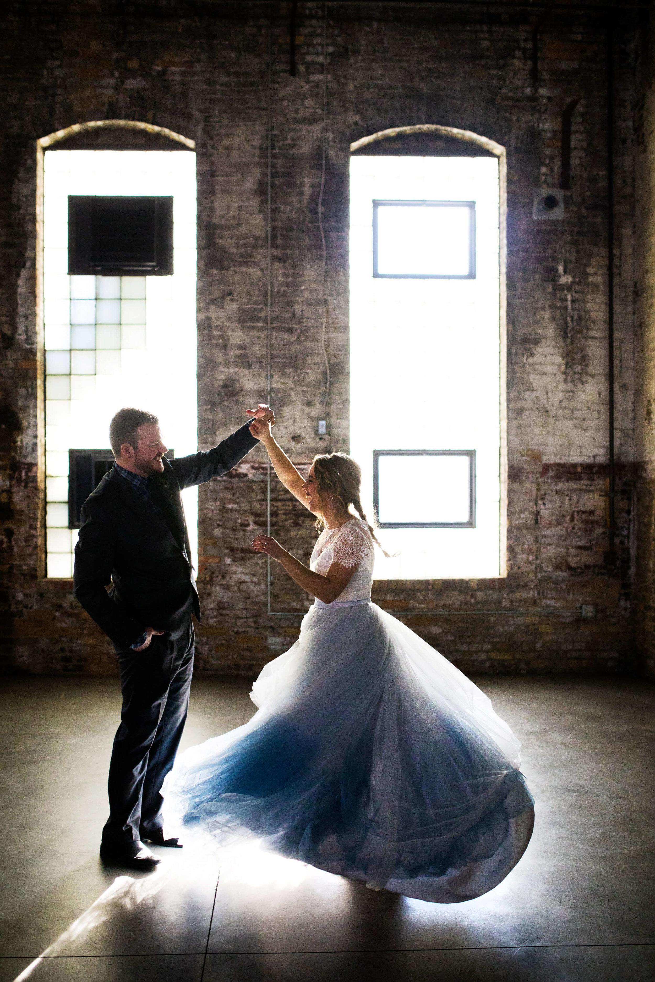 twirl photo | bride with single braid | blue tulle gown | Minnesota wedding photographer Studio KH wedding dress details | wedding blog | Sixpence Events 70 Ways to Photograph Your Wedding Dress.jpg