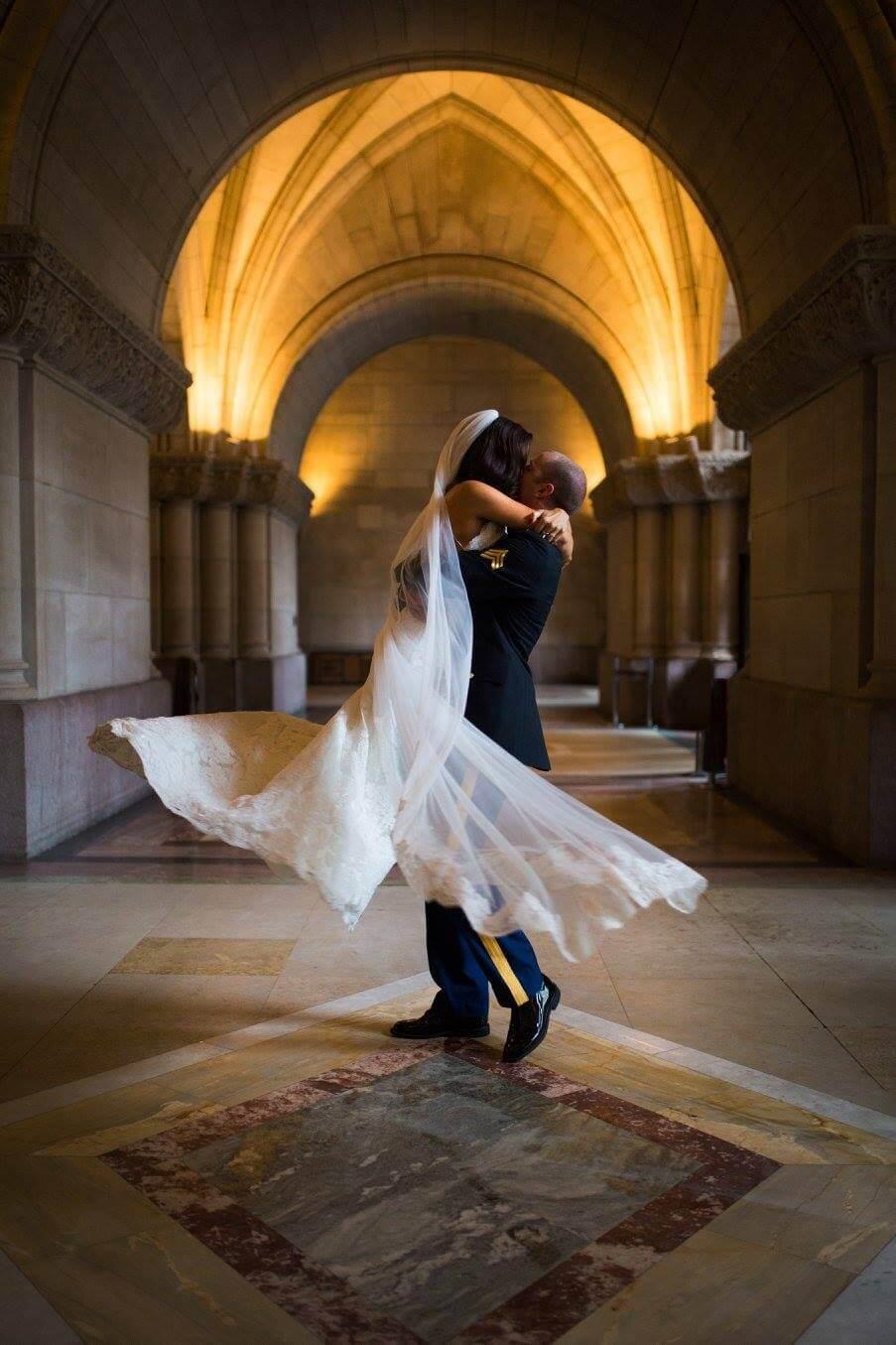 groom twirling his bride | Minnesota wedding photographer Studio KH wedding dress details | wedding blog | Sixpence Events 70 Ways to Photograph Your Wedding Dress.jpg