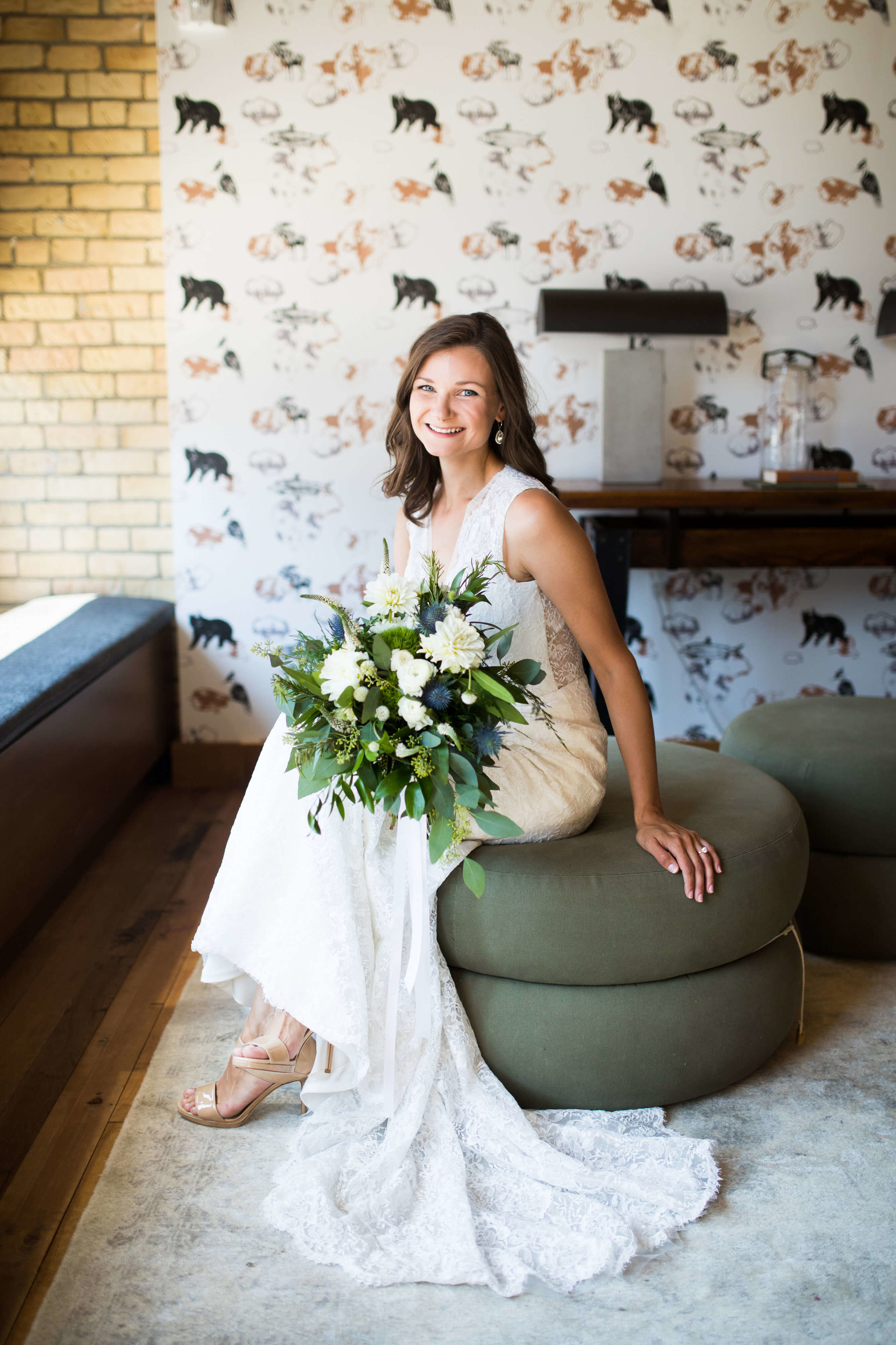 bride sitting on ottoman | Minnesota wedding photographer Studio KH wedding dress details | wedding blog | Sixpence Events 70 Ways to Photograph Your Wedding Dress.jpg