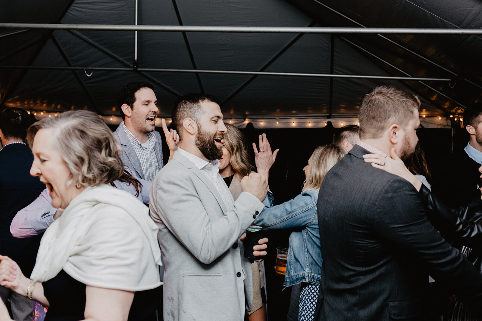 Alex + Lisi -- backyard Minnesota wedding -- Mads Lizotte photography -- Sixpence Events -- best lighting for dance photos in a tent.jpg