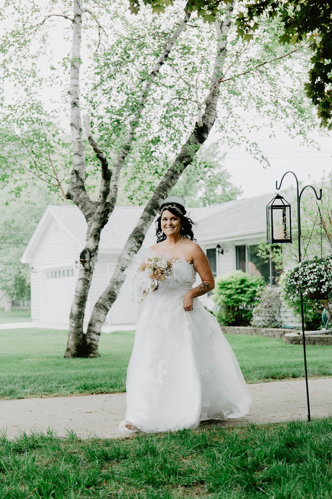Alex + Lisi -- backyard Minnesota wedding -- Mads Lizotte photography -- Sixpence Events -- bride processional solo.jpg