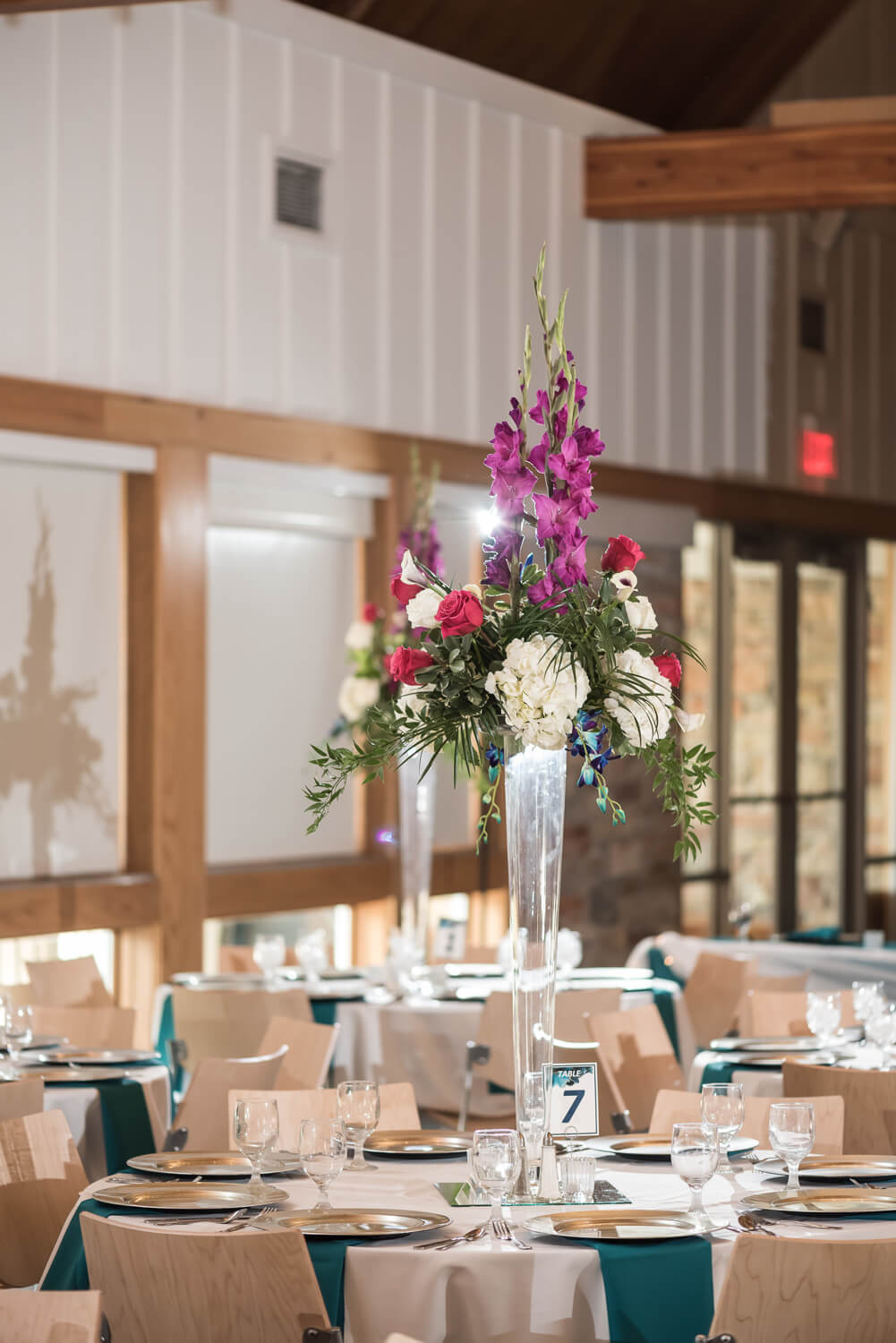 K Solberg Photography | Elm Creek Chalet | Minneapolis day of coordinator Sixpence Events | tall pilsner floral centerpiece with calla lilies