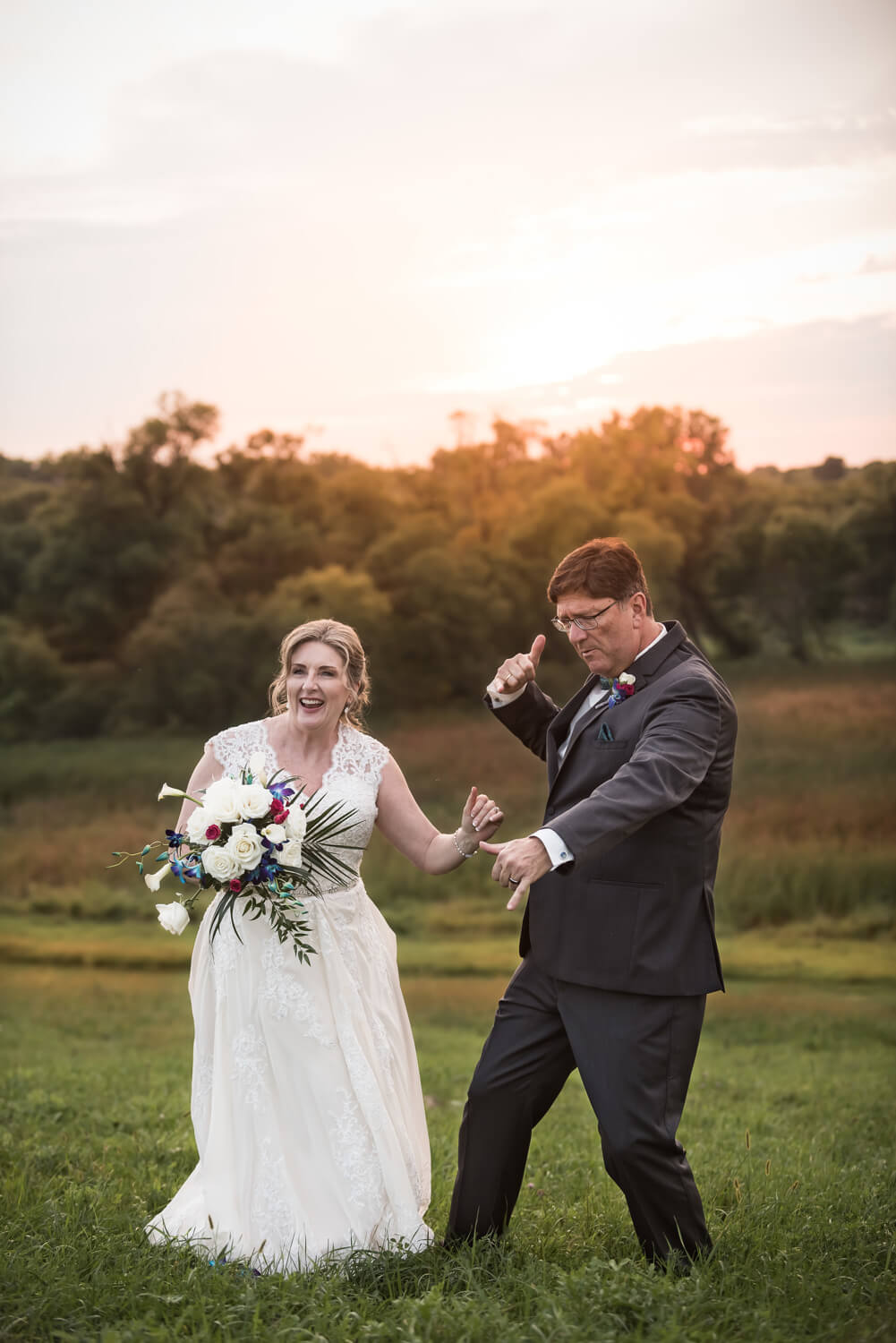 K Solberg Photography | Elm Creek Chalet | Minneapolis day of coordinator Sixpence Events | dancing sunset photo