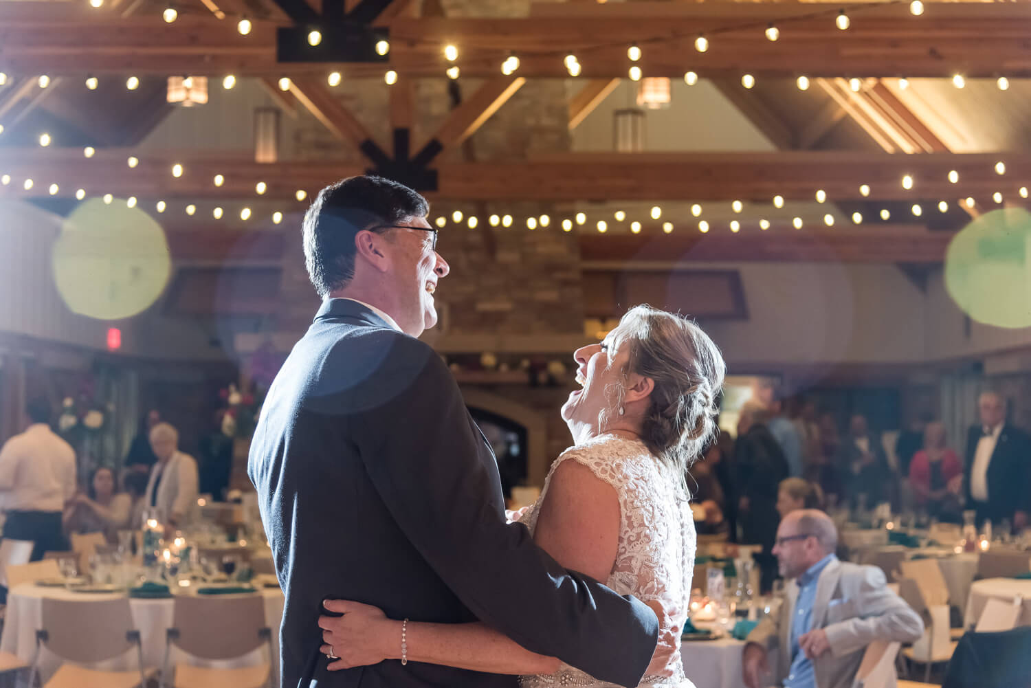 K Solberg Photography | Elm Creek Chalet | Minneapolis day of coordinator Sixpence Events | first dance with cafe lights