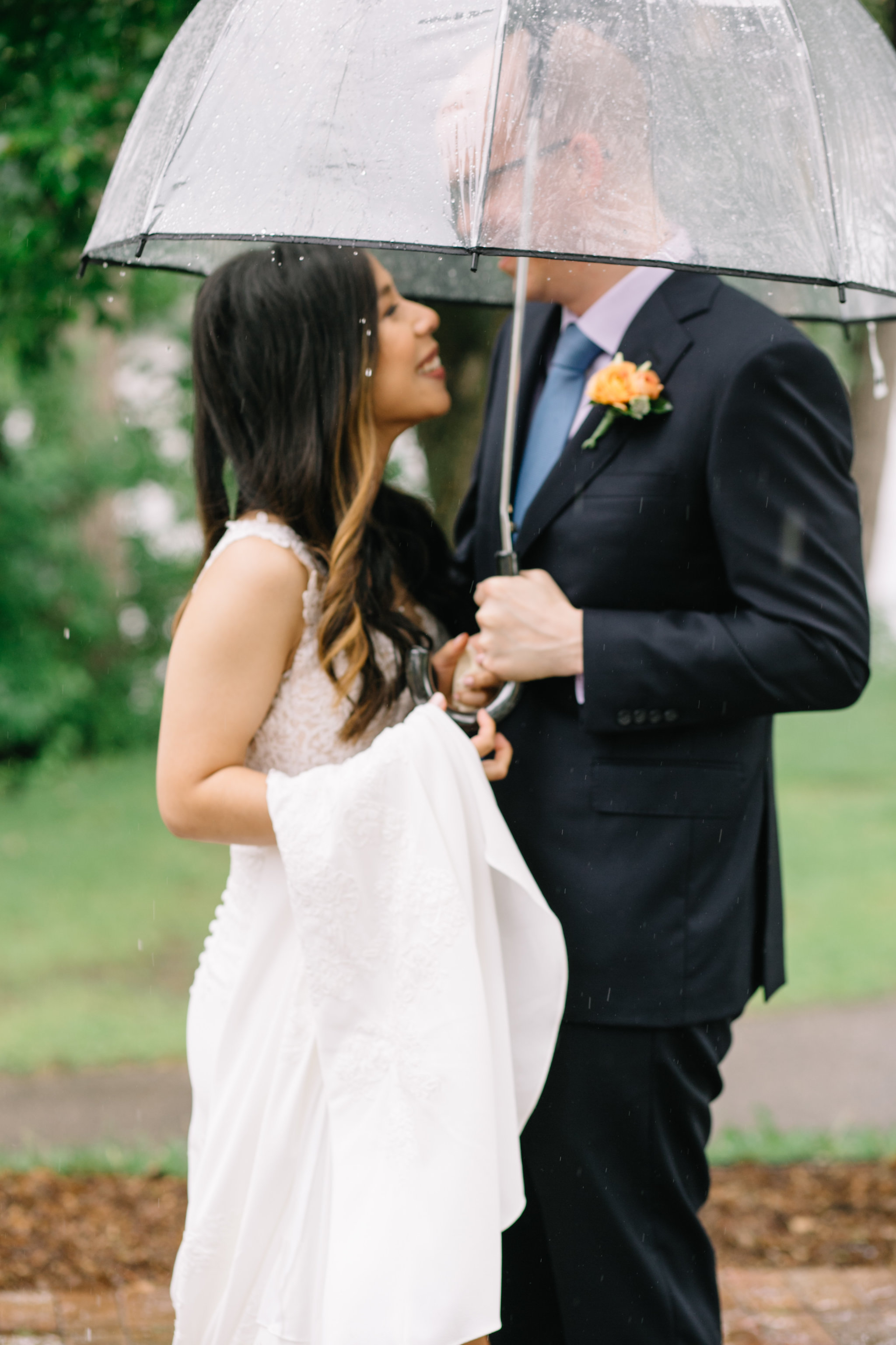 rain wedding photo, Whims and Joy Minneapolis photographer :: Sixpence Events & Planning Minnesota wedding planner :: Nicollet Island Pavilion.jpg