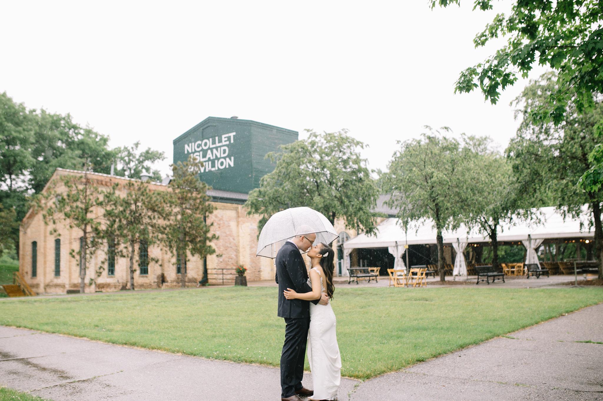 clear umbrella, Whims and Joy Minneapolis photographer :: Sixpence Events & Planning Minnesota wedding planner :: Nicollet Island Pavilion.jpg