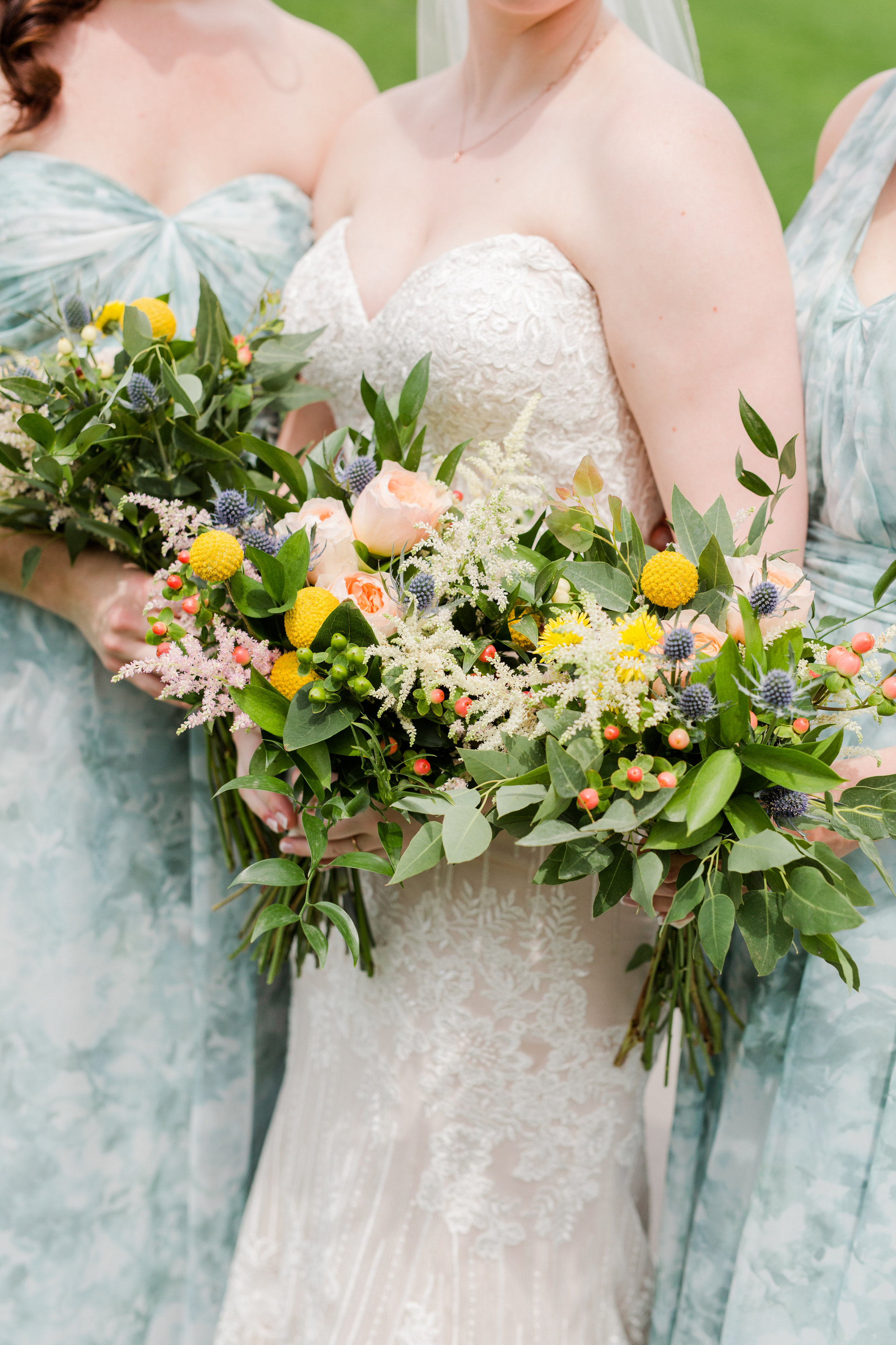 Jill + John :: Kristen Dryer :: Sixpence Events, bloom and buttercup bridesmaid bouquets with blue thistle and hypericum berries, pop of yellow (button mum)