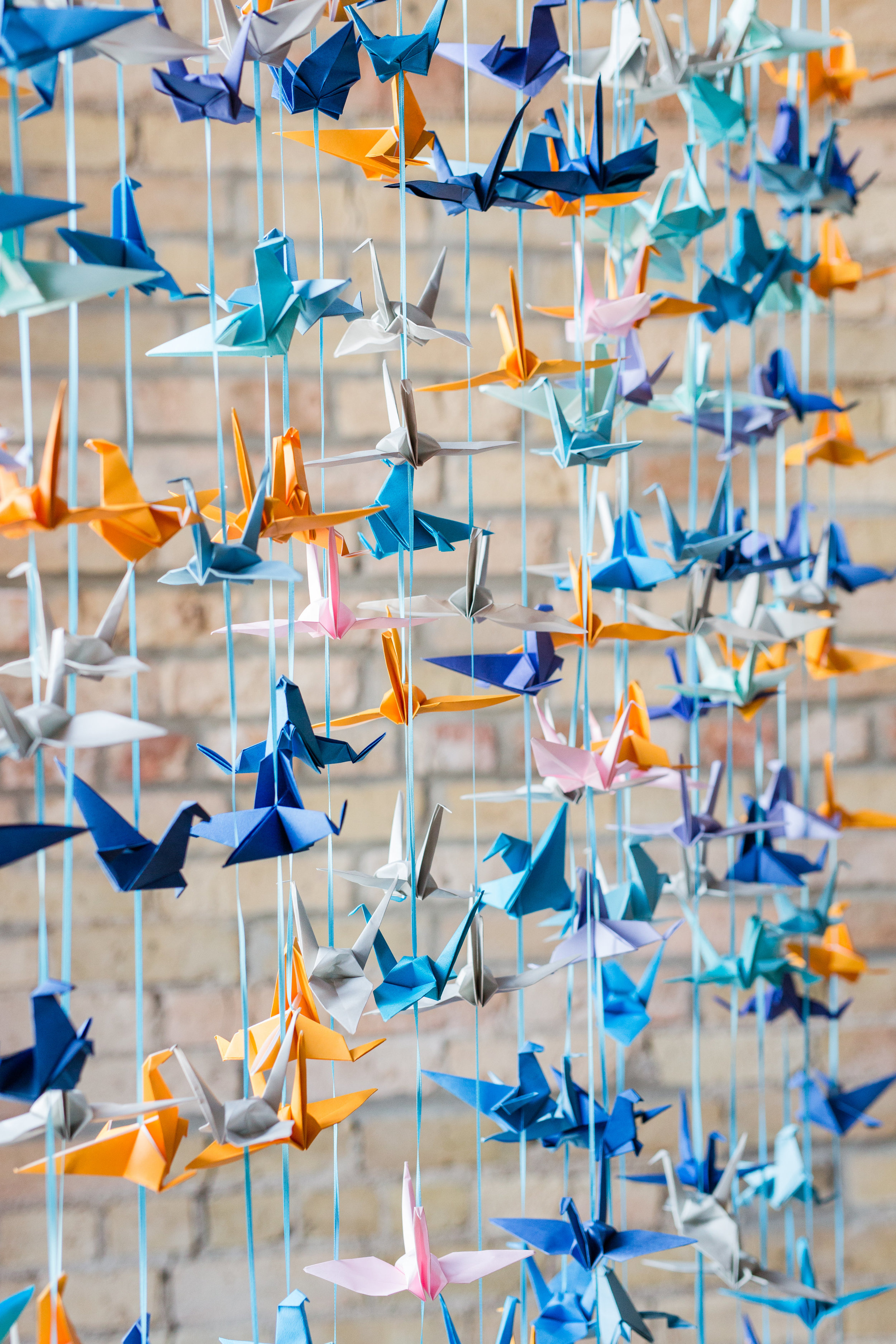 Jill + John :: Kristen Dyer :: Sixpence Events, paper cranes in blues, light blue, orange and pink