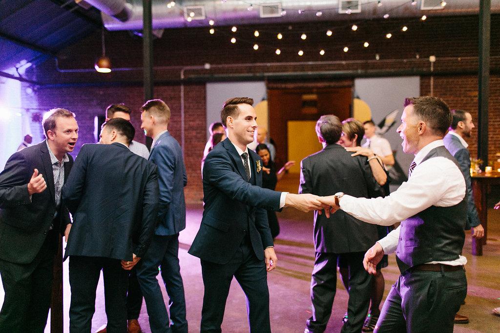 Carly Milbrath Photography   Justin and Jacob   PAIKKA Minnesota Wedding Venue   Same sex wedding with two grooms dancing