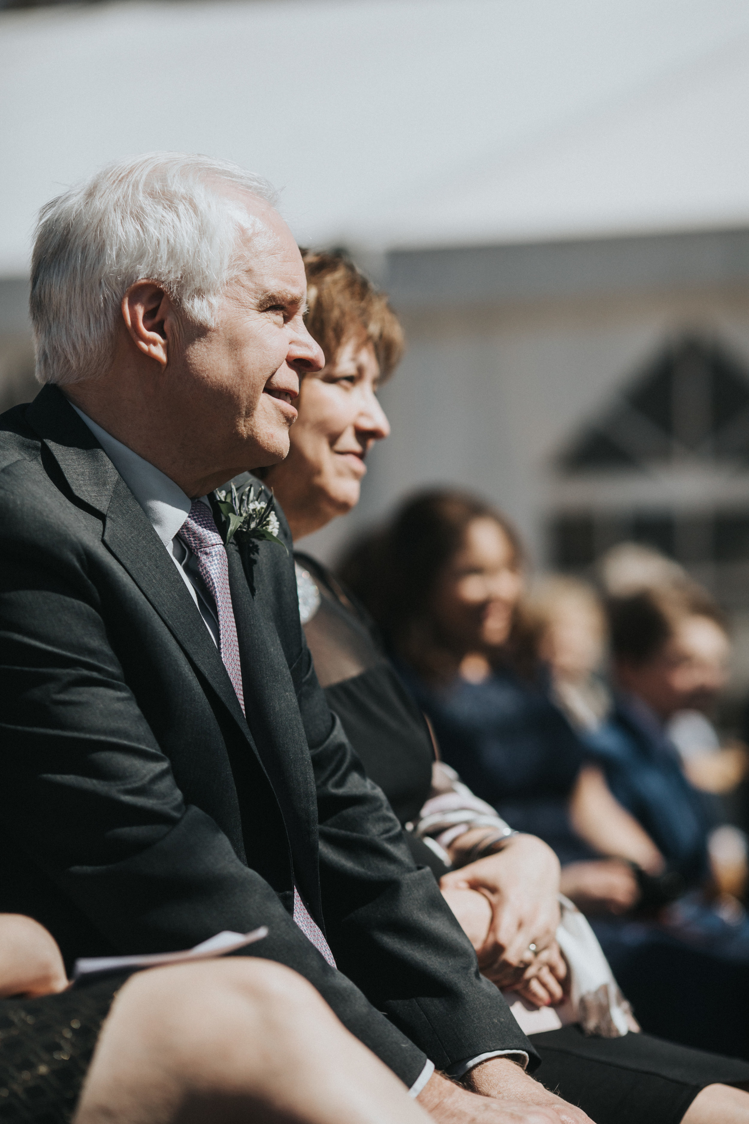 happy wedding guests during the ceremony, Russell Heeter Photography :: Minneapolis wedding planner Sixpence Events :: Nicollet Island Pavilion :: april wedding in Minnesota.jpg