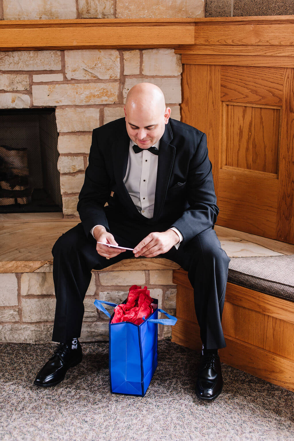Laura Haya Photography | Sixpence Events Day of Coordinating | Bunker Hills Event Center Minnesota | groom opening his gift