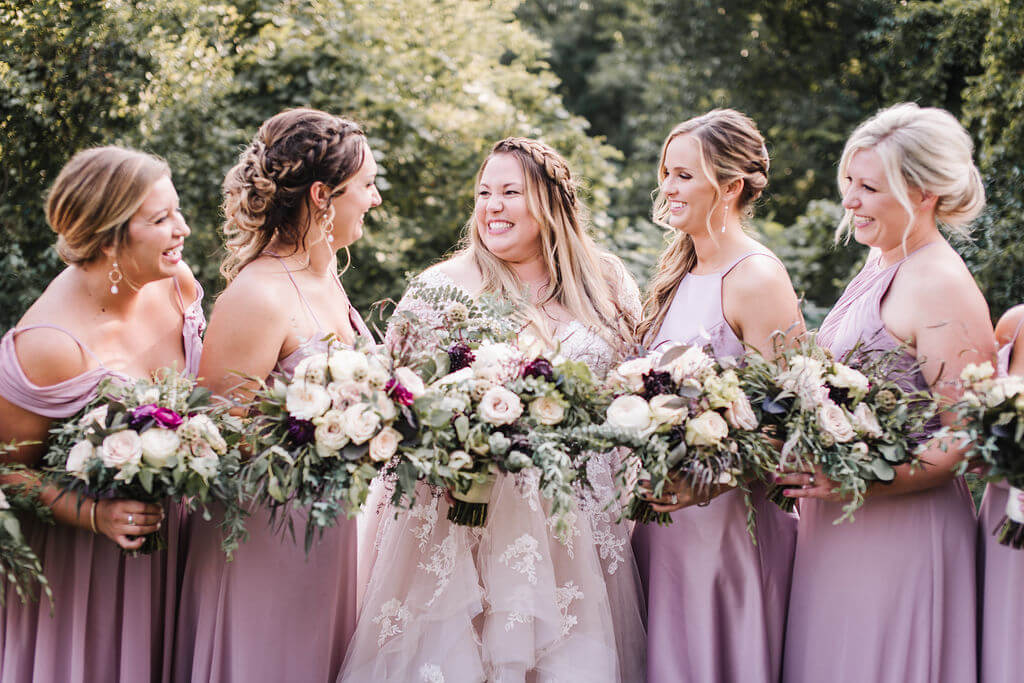 Laura Haya Photography | Sixpence Events Day of Coordinating | Bunker Hills Event Center Minnesota | lavender bridesmaids with braids