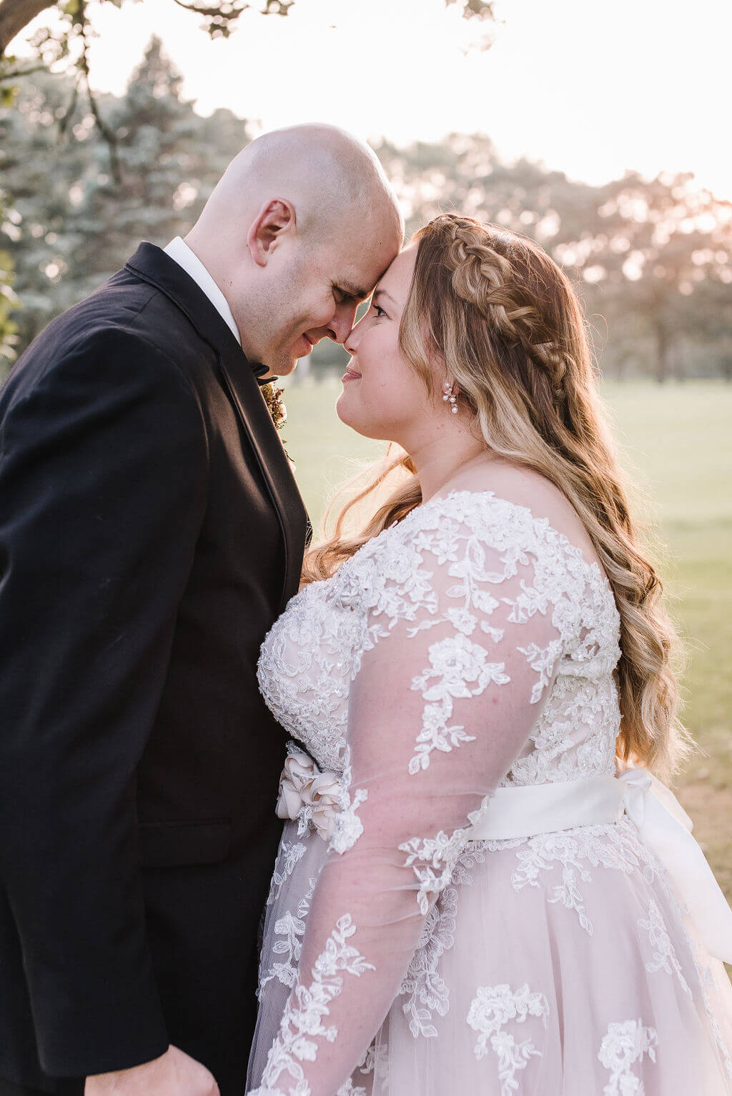 Laura Haya Photography | Sixpence Events Day of Coordinating | Bunker Hills Event Center Minnesota | forehead touch sunset photo on the golf course