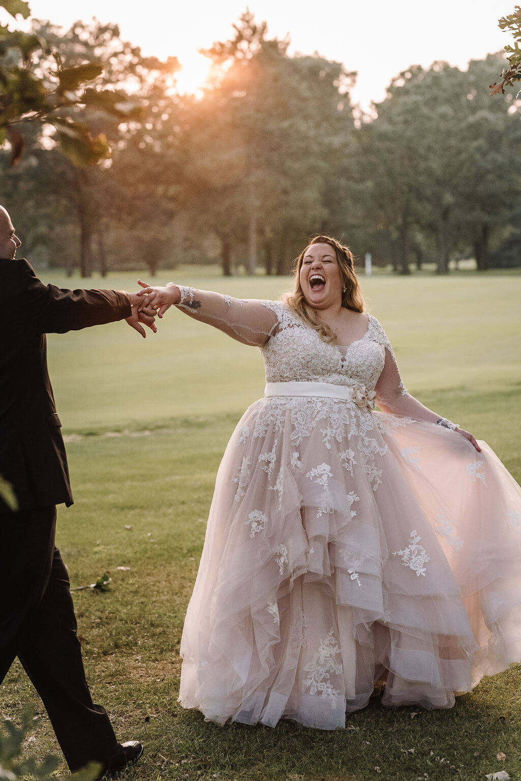 Laura Haya Photography | Sixpence Events Day of Coordinating | Bunker Hills Event Center Minnesota twirl picture, bride so happy