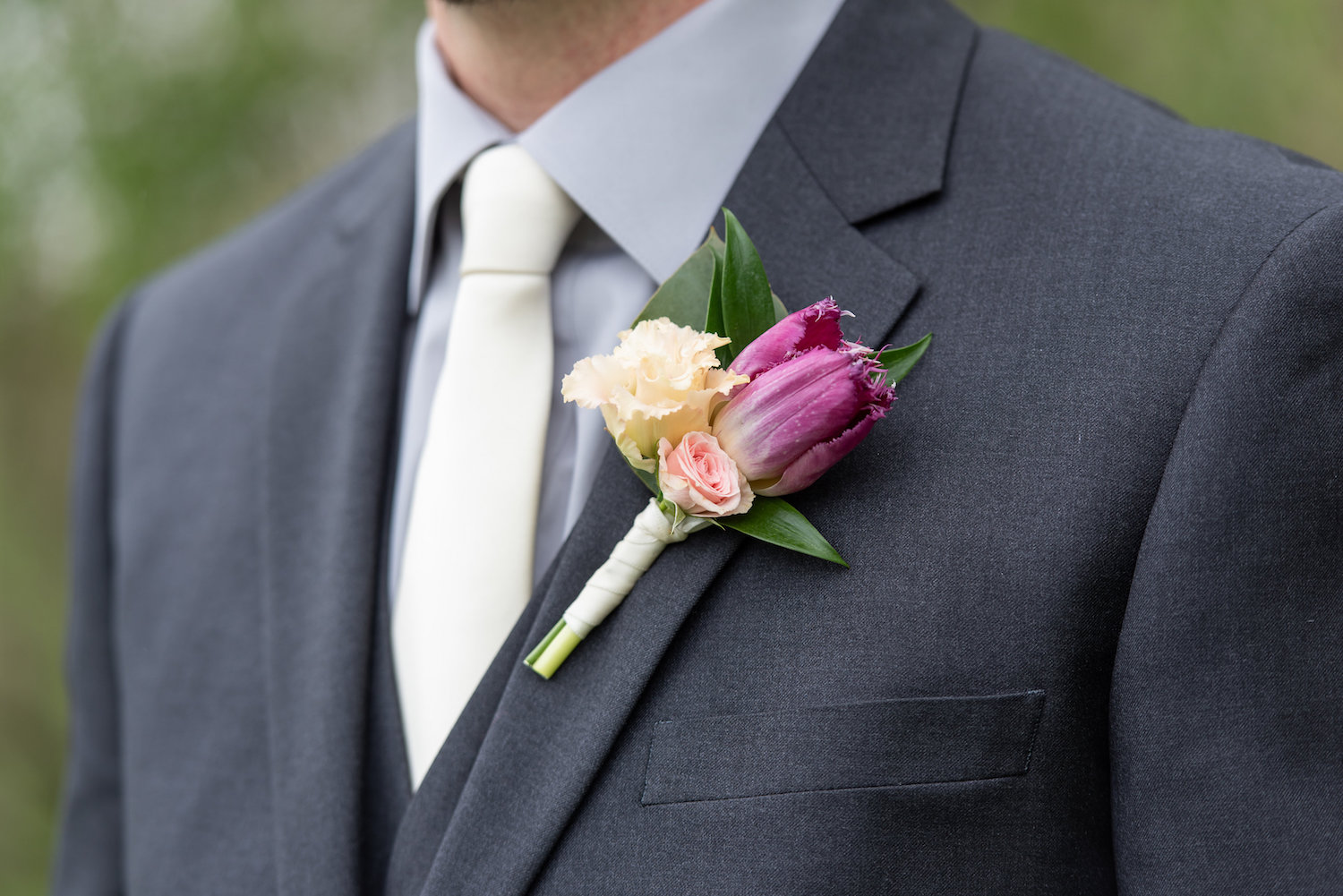 Sarah and Mark | Hope Glen Farm | Kelly Birch Photo | Sixpence Events & Planning wedding planning in Minnesota | tulip boutonniere | white tie with grey suit and grey shirt with vest