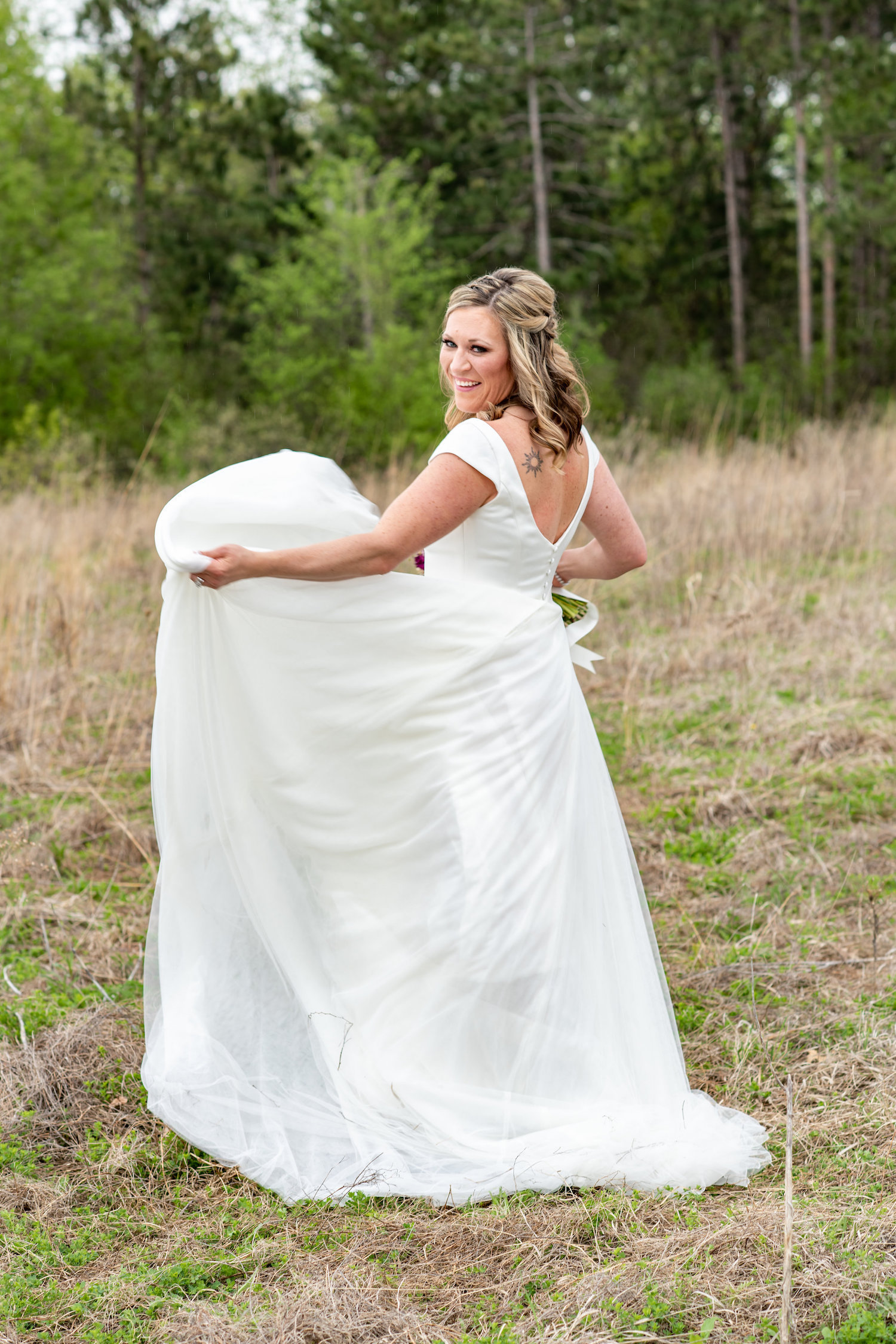 Sarah and Mark | Hope Glen Farm | Kelly Birch Photo | Sixpence Events & Planning wedding planning in Minnesota | bride twirling in sleeved dress with back tattoo