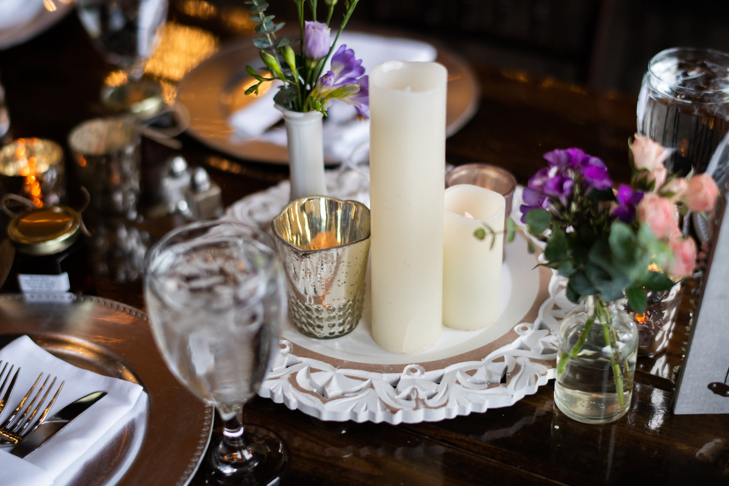 Sarah and Mark | Hope Glen Farm | Kelly Birch Photo | Sixpence Events & Planning wedding planning in Minnesota | led candles | frame tray with milk bud cases and purple lisianthus
