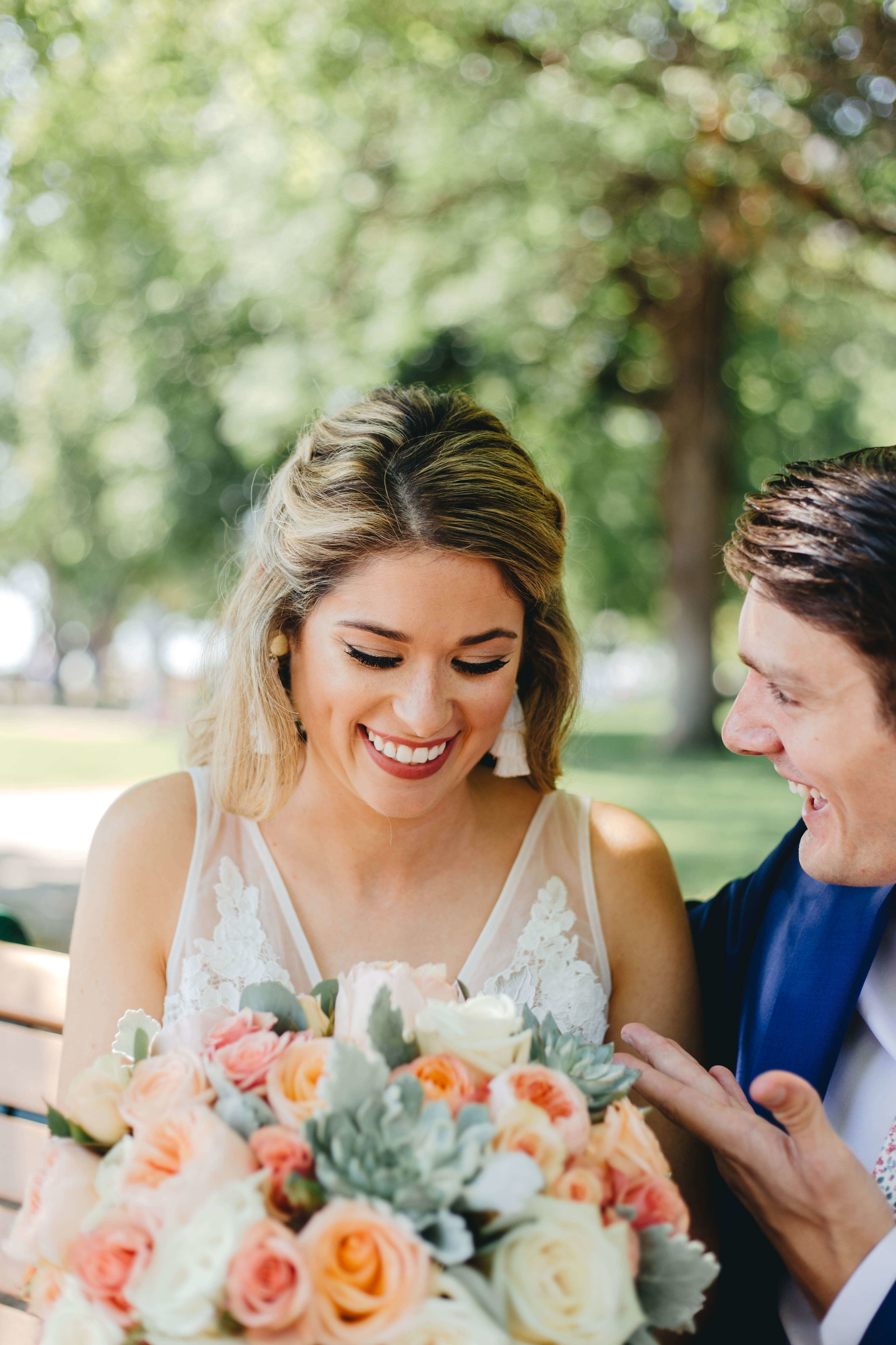 Roy Son Photography | Raspberry Island and Octo Fish bar | Minneapolis wedding planner Sixpence Events | coral and succulent bride bouquet