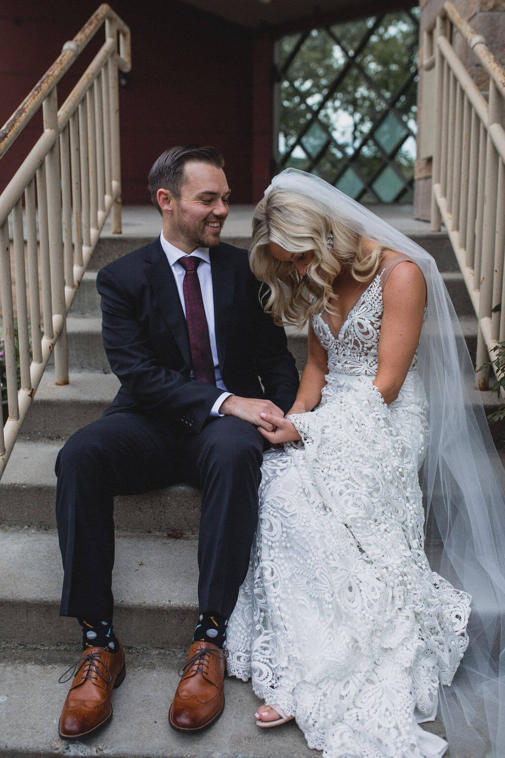 Ashley and Tom | Mariah Brink Photo | Hyland Hills Wedding | Sixpence MN wedding planner | Photo on the stairs | groom in dark navy burgundy and copenhagen shoes