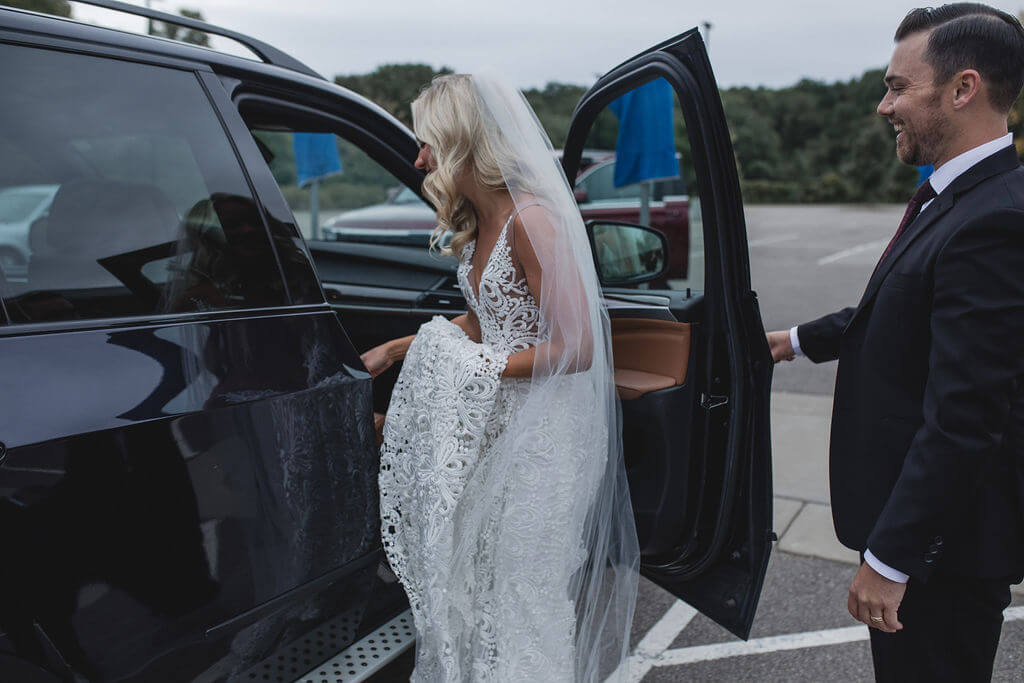 Ashley and Tom | Mariah Brink Photo | Hyland Hills Wedding | Sixpence MN wedding planner | getting into the car photo