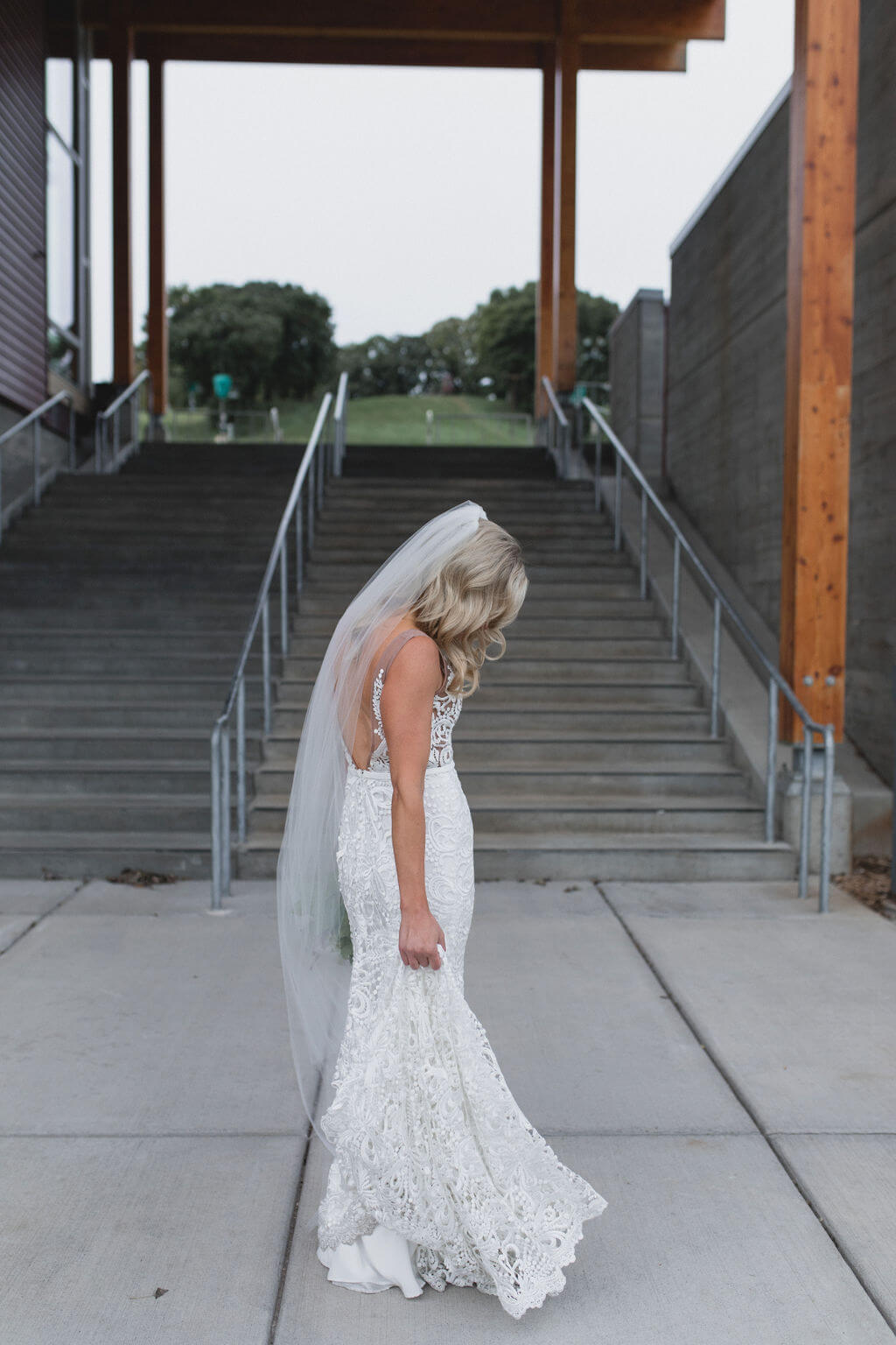 Ashley and Tom | Mariah Brink Photo | Hyland Hills Wedding | Sixpence MN wedding planner | bride in front of stairs