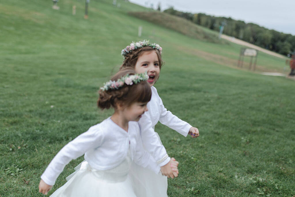 Ashley and Tom | Mariah Brink Photo | Hyland Hills Wedding | Sixpence MN wedding planner | flower girls with crowns in white cardigans and tutus