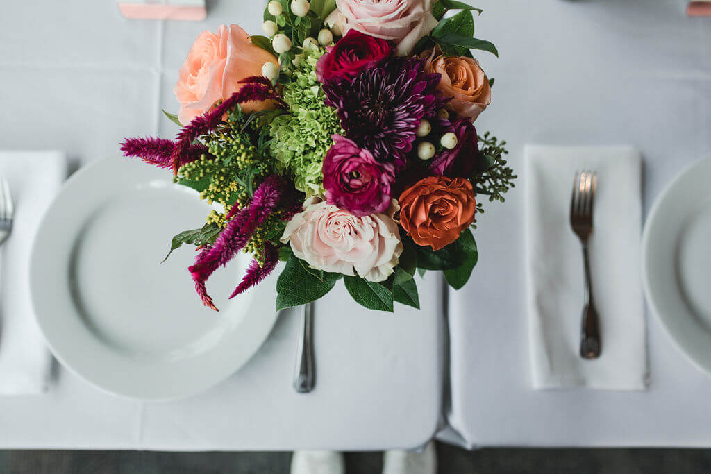 Ashley and Tom | Mariah Brink Photo | Hyland Hills Wedding | Sixpence MN wedding planner | bright bouquet with roses and ranunculus, hypericum berries | The Wild Orchid